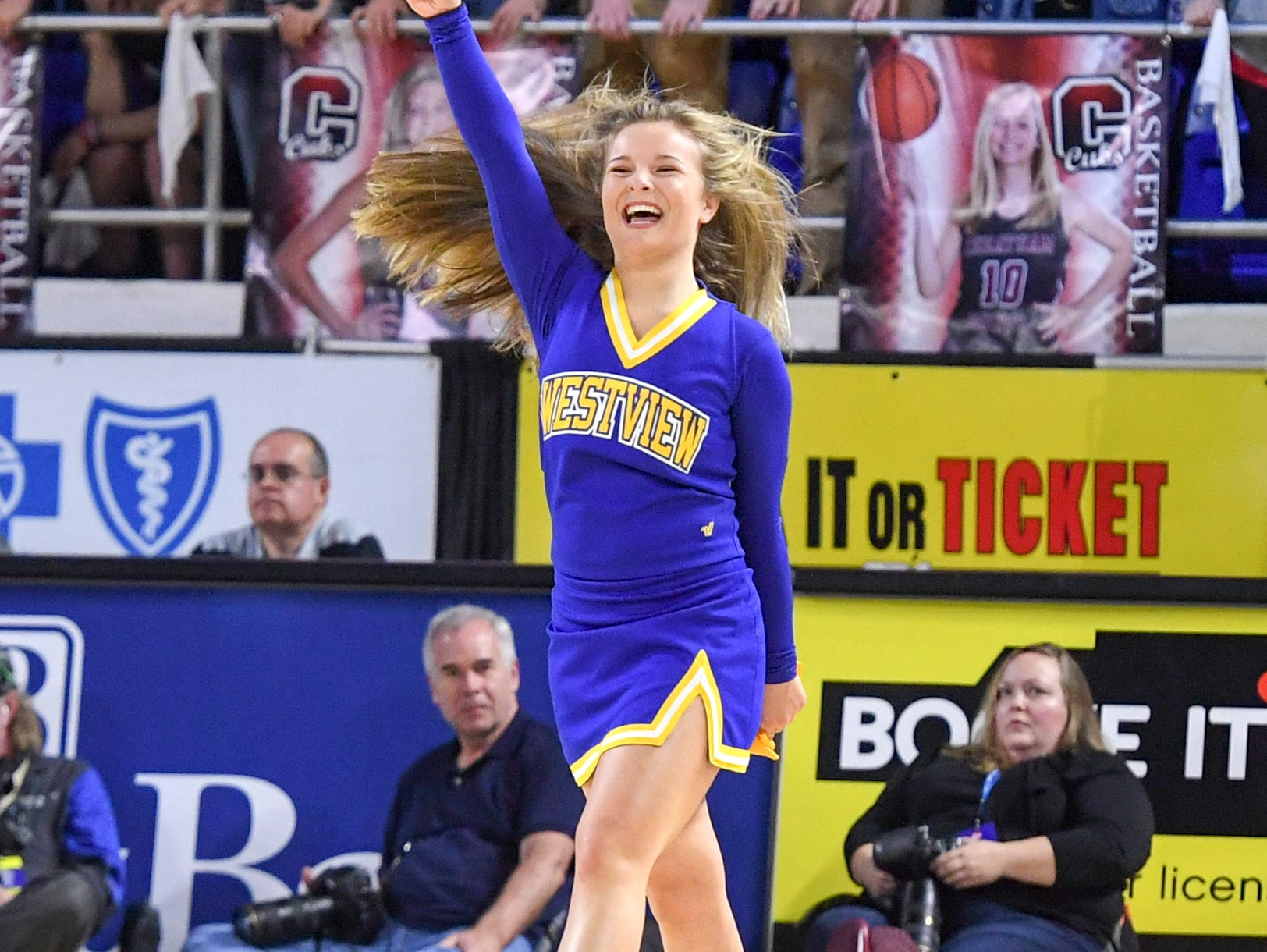 Westview High School cheerleader Kaylee Tims cheers her team after doing back flips during a timeout during their Class AA championship game, Saturday, March 9, 2019, in Murfreesboro. Westview fell to Cheatham County, 43-40.