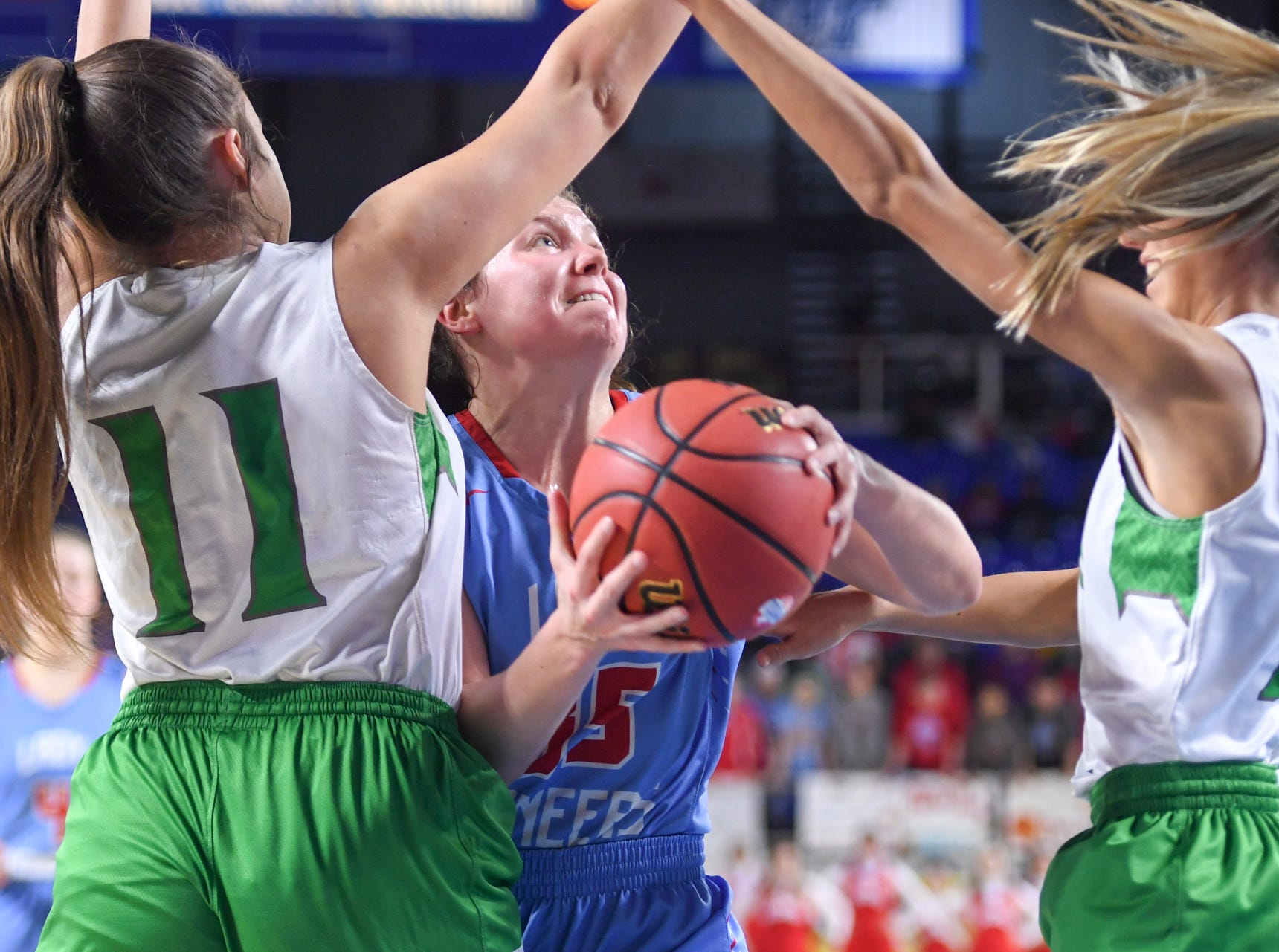 Gibson County's Hannah Ball (35) tries to get between Midway's Megan Norman (11) and Midway's Sophia Patterson (13) during their Class A semifinal game, Friday, March 8, 2019, in  Murfreesboro.