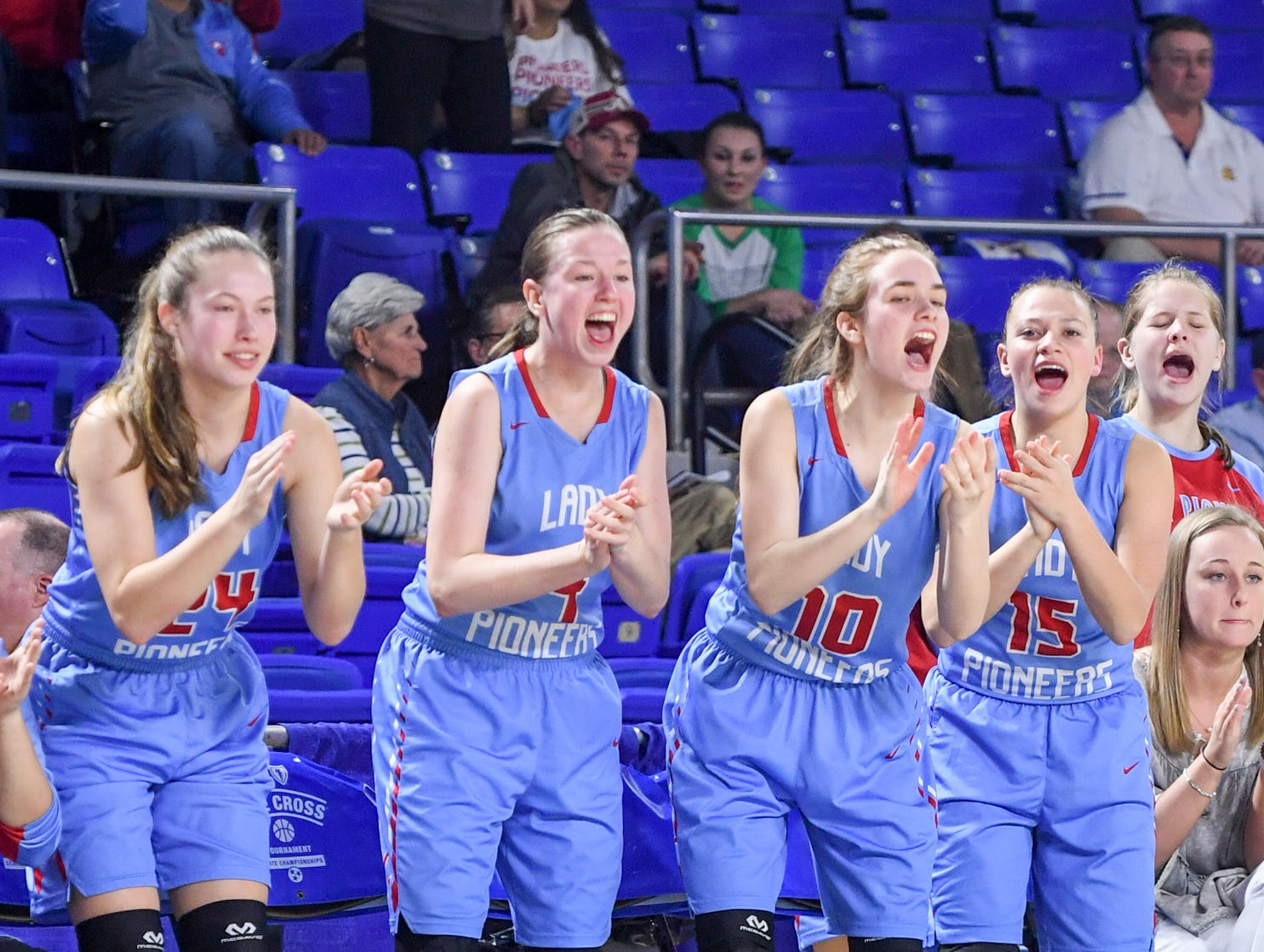 Gibson County's Madison Hart (24), Annie Bass (4), Kaci Sweatt (10) and Jaci White (15) cheer on their team during their Class A semifinal game against Midway, Friday, March 8, 2019, in  Murfreesboro. Gibson County defeated Midway, 75-61.