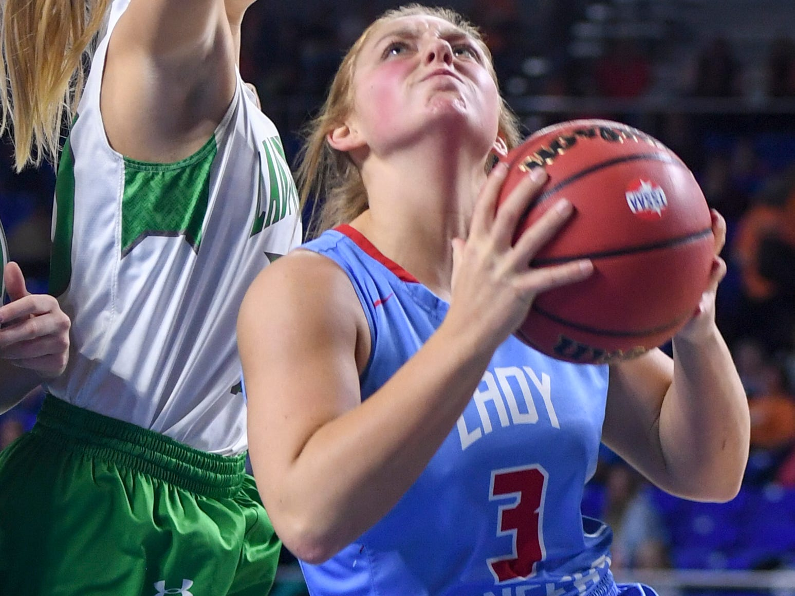 Gibson County's Macey Neal (3) goes up for a shot as a Midway defender reaches over her to block her shot during their Class A semifinal game, Friday, March 8, 2019, in  Murfreesboro.