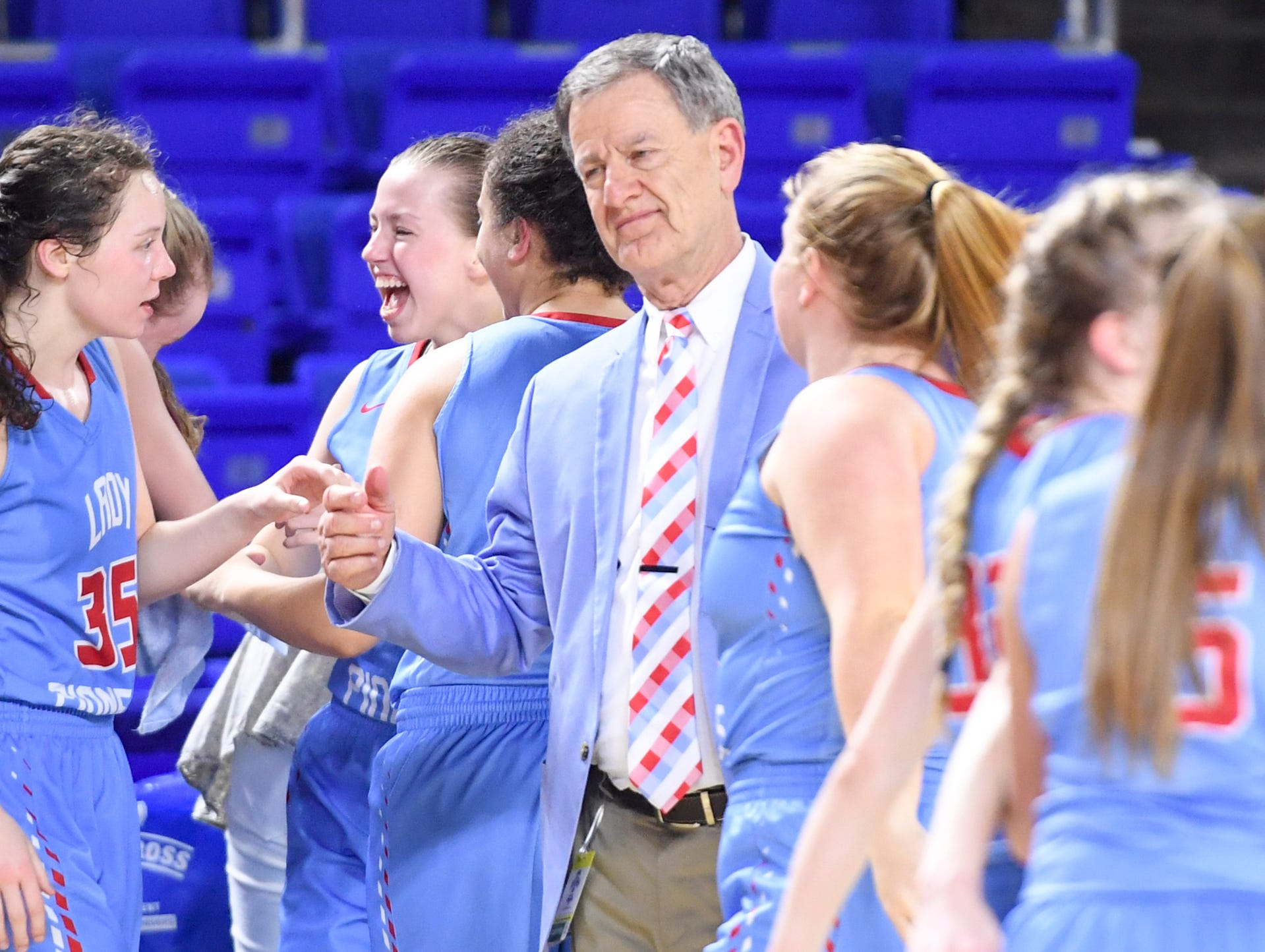 Gibson County's head girls basketball coach Mitch Wilkins celebrates with his team at the end of their Class A semifinal game against Midway, Friday, March 8, 2019, in  Murfreesboro. Gibson County defeated Midway, 75-61.