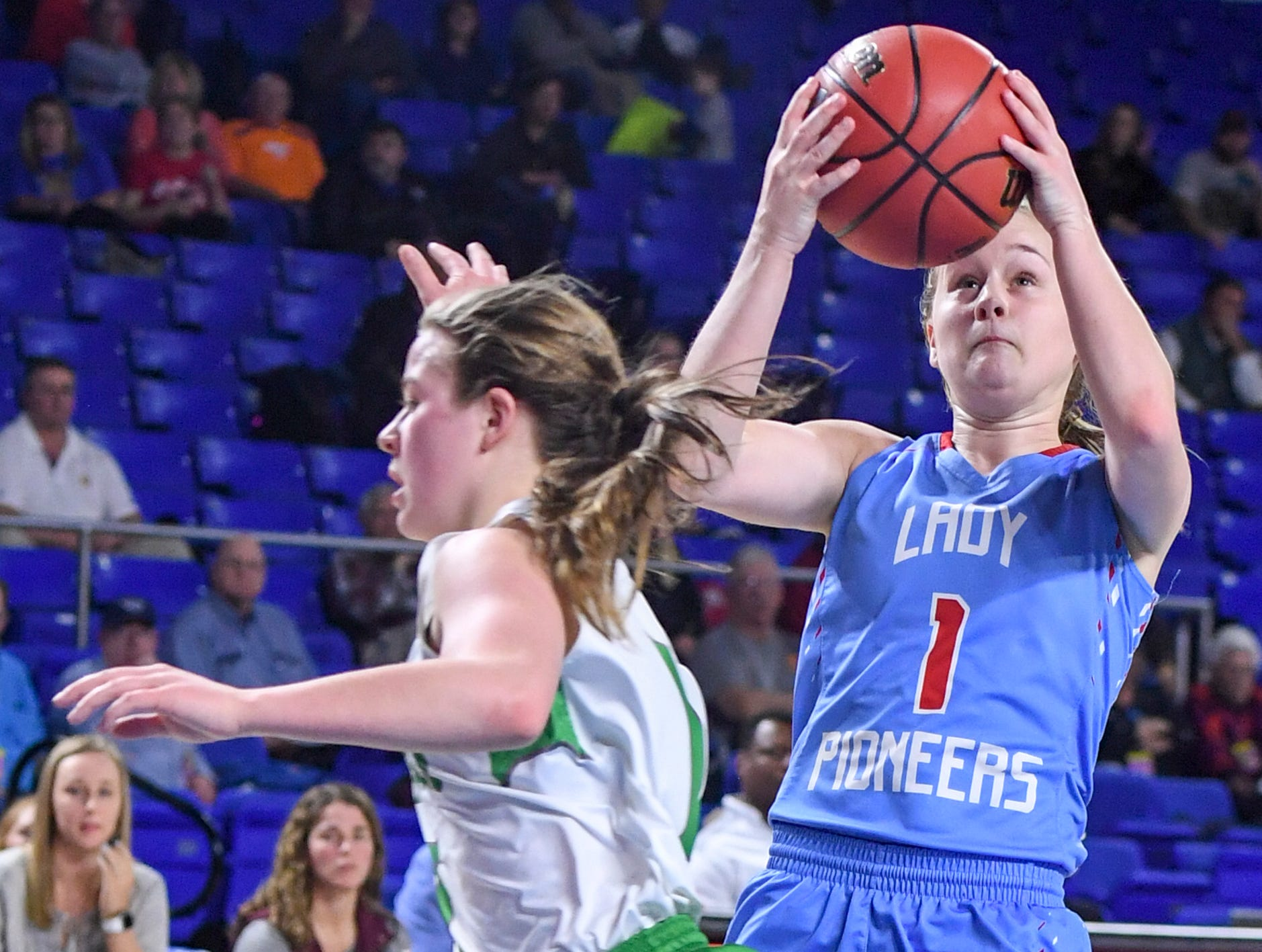 Midway's Caitlyn Ross (1) runs past Gibson County's Ashton Lannom (1) during their Class A semifinal game, Friday, March 8, 2019, in  Murfreesboro. Gibson County defeated Midway, 75-61.