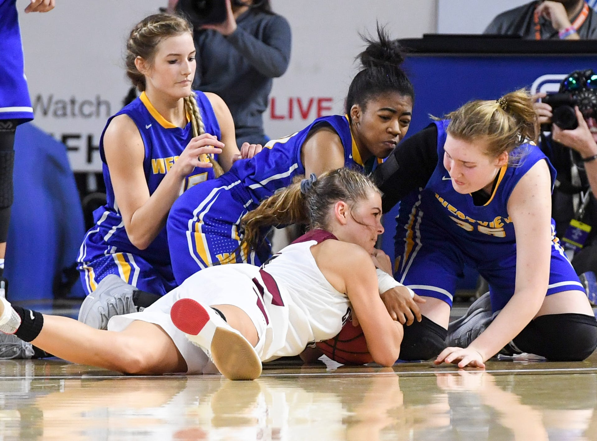 Westview's Alex Callins (15) Westview's Zanasha Gadlen (10) and Westview's Avery Leyhue (35) battle for possession of a loose ball during their Class AA championship game, Saturday, March 9, 2019, in Murfreesboro. Westview fell to Cheatham County, 43-40.
