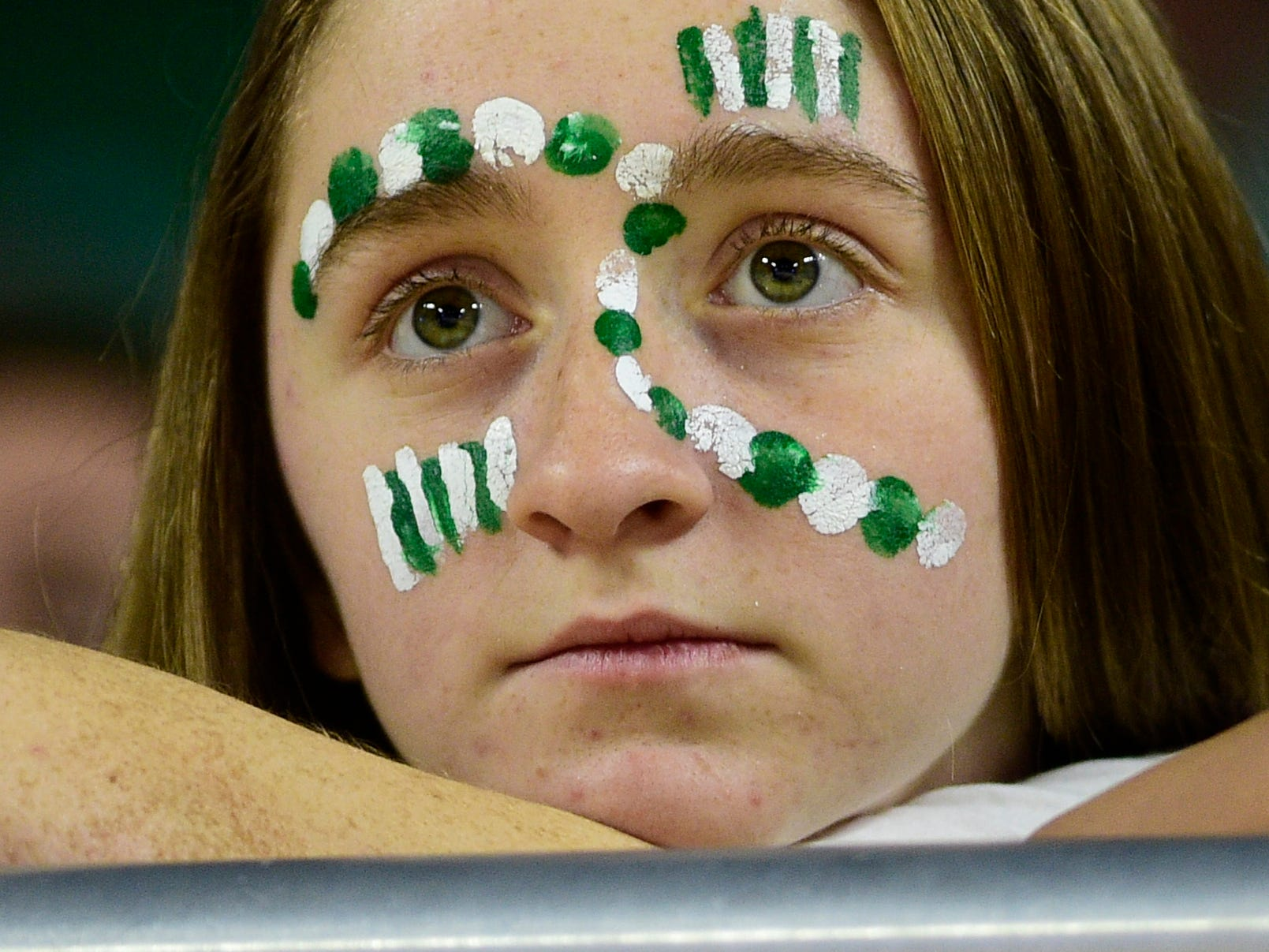 A Midway fan watches as the team begins falling behind during a game between Midway and Gibson County at the TSSAA girls state tournament at the Murphy Center in Murfreesboro, Tennessee on Friday, March 8, 2019.