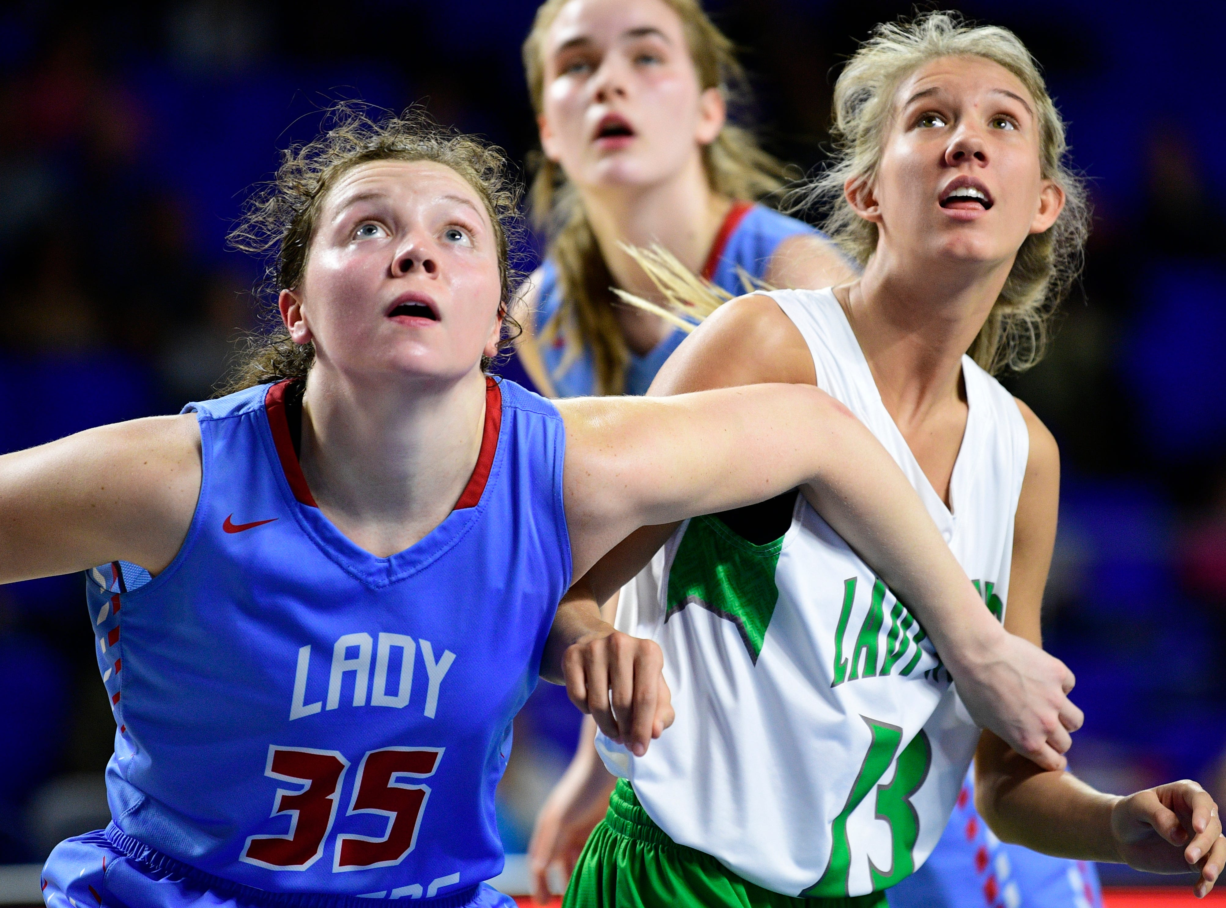 Gibson County's Hannah Ball (35) and Midway's Sophia Patterson (13) eye the rebound during a game between Midway and Gibson County at the TSSAA girls state tournament at the Murphy Center in Murfreesboro, Tennessee on Friday, March 8, 2019.