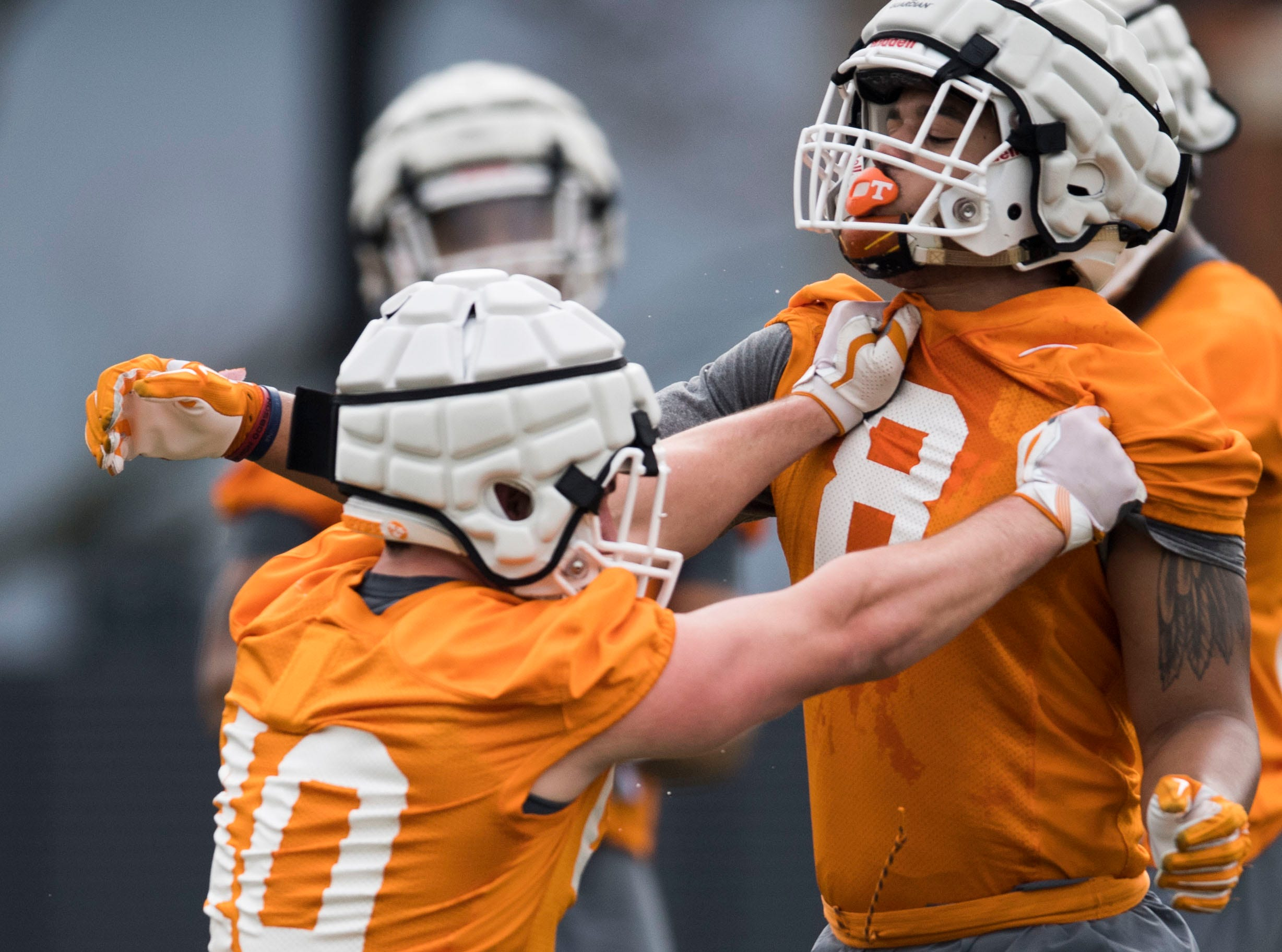 Tennessee's Matt Ballard (40) and Jordan Allen (8) participate in a drill during a Tennessee Vols football spring practice Saturday, March 9, 2019.
