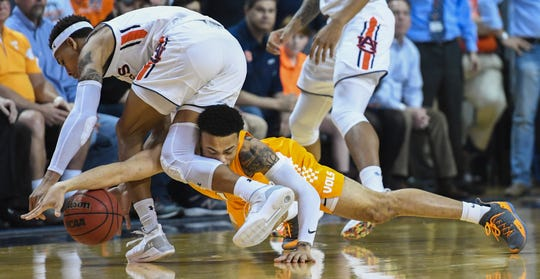 Tennessee guard Lamonte Turner (1) takes the ball from Auburn guard Bryce Brown (2) during the first half of an NCAA college basketball game Saturday, March 9, 2019, in Auburn, Ala.