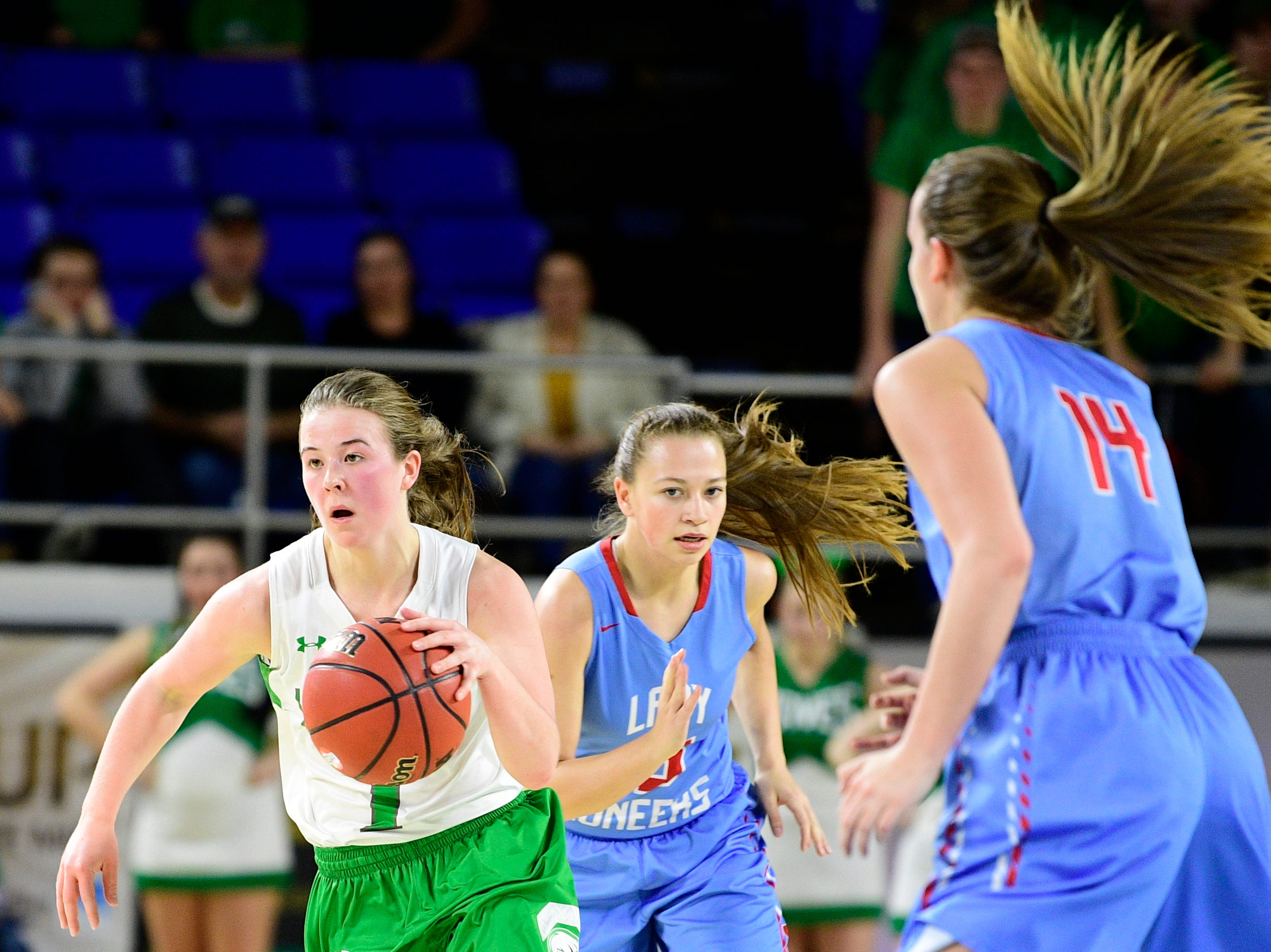 Midway's Caitlyn Ross (1) dribbles down the court past Gibson County's Alaina Hunt (14) and Gibson County's Ashton Lannom (1) during a game between Midway and Gibson County at the TSSAA girls state tournament at the Murphy Center in Murfreesboro, Tennessee on Friday, March 8, 2019.