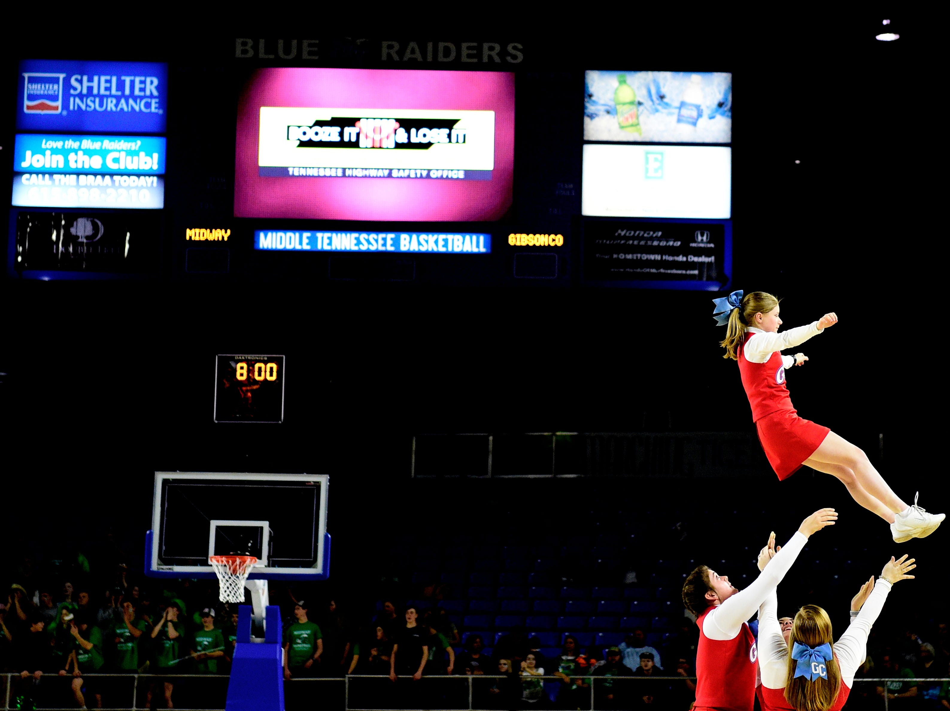 Gibson Co. cheerleaders perform during a game between Midway and Gibson County at the TSSAA girls state tournament at the Murphy Center in Murfreesboro, Tennessee on Friday, March 8, 2019.