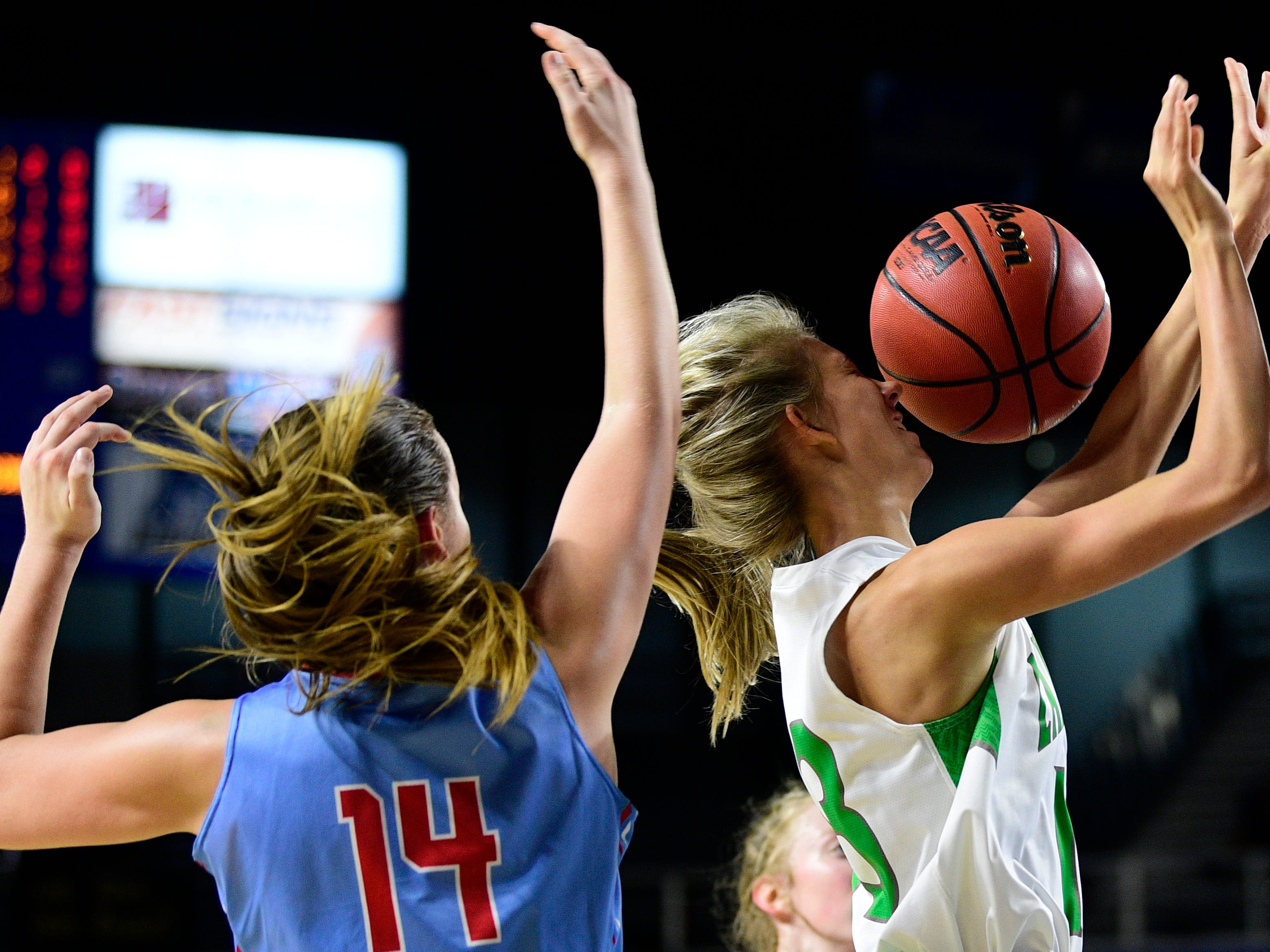 Midway's Sophia Patterson (13) is hit in the face with the ball after her shot is blocked during a game between Midway and Gibson County at the TSSAA girls state tournament at the Murphy Center in Murfreesboro, Tennessee on Friday, March 8, 2019.