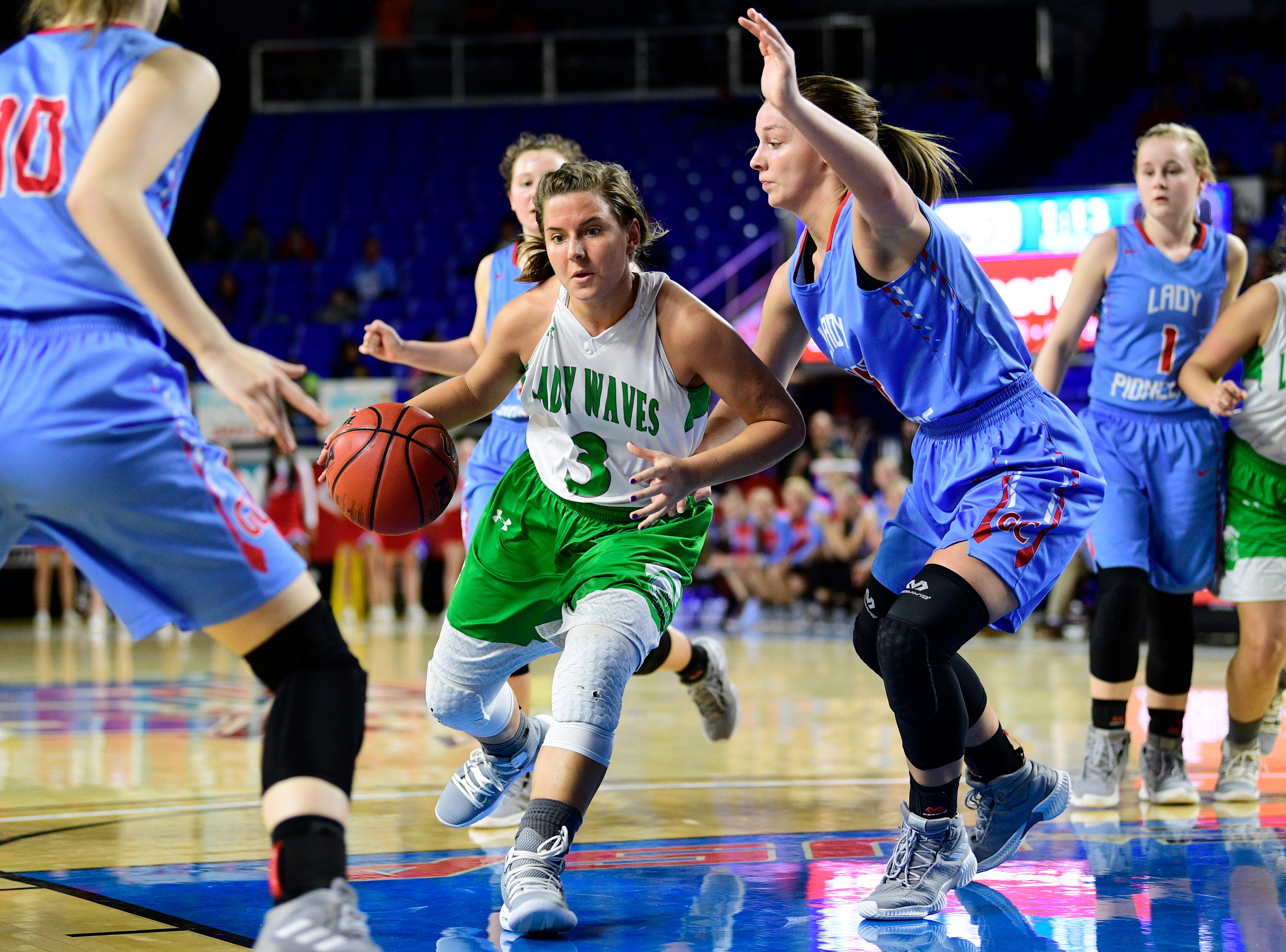 Midway's Rebecca Lemasters (3) looks for a way through the defense during a game between Midway and Gibson County at the TSSAA girls state tournament at the Murphy Center in Murfreesboro, Tennessee on Friday, March 8, 2019.