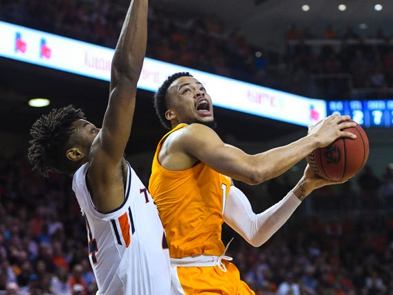 Auburn forward Anfernee McLemore (24) defends as Tennessee guard Lamonte Turner (1) looks to shoot during the first half of an NCAA college basketball game Saturday, March 9, 2019, in Auburn, Ala.