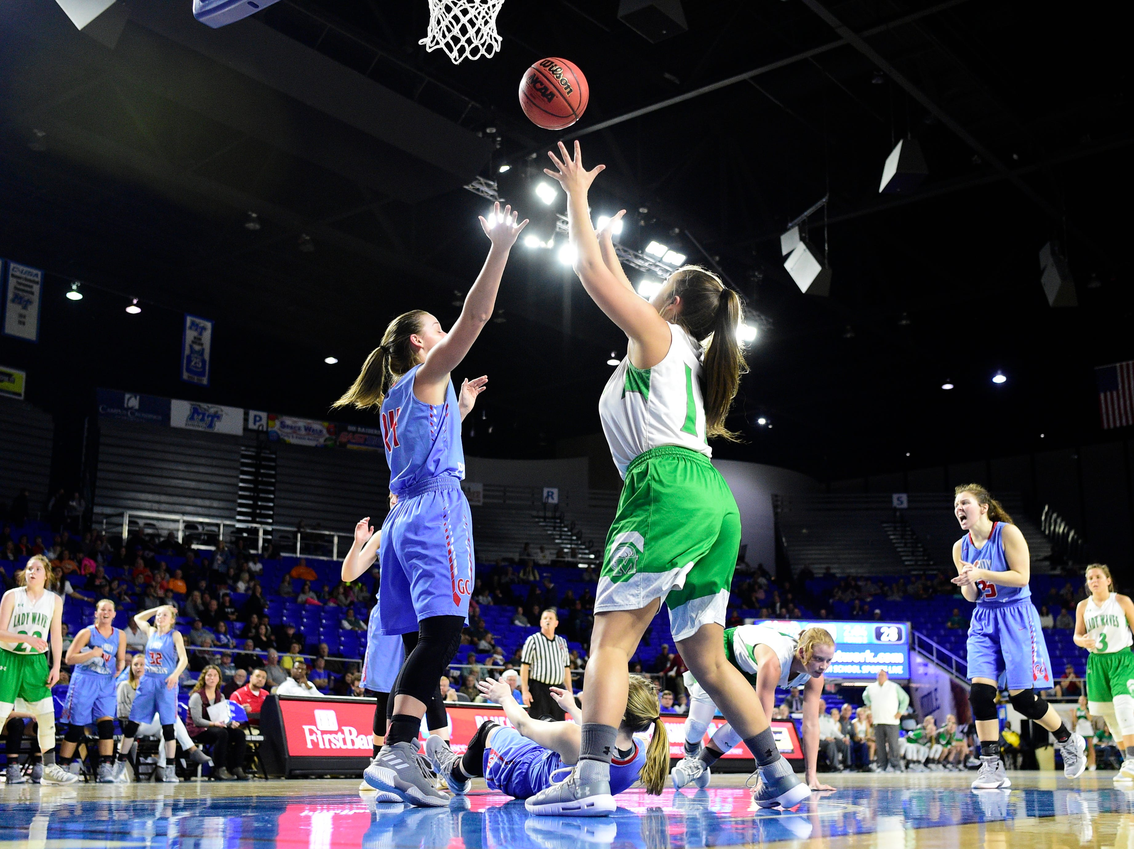 Greenfield's Tess Darby (10) and Gibson County's Alaina Hunt (14) reach for the ball during a game between Midway and Gibson County at the TSSAA girls state tournament at the Murphy Center in Murfreesboro, Tennessee on Friday, March 8, 2019.