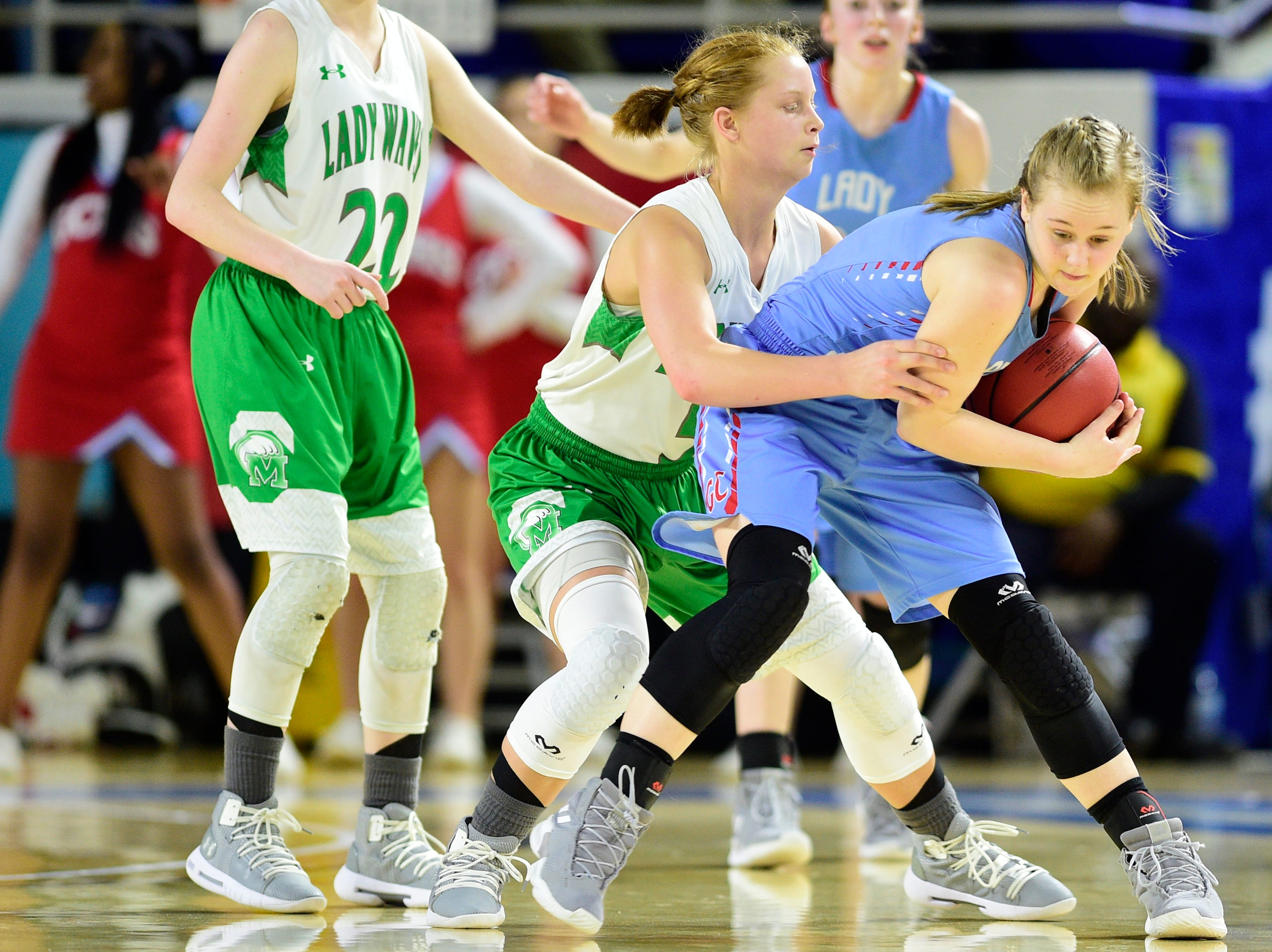Midway's Paige Bacon (5) defends against Gibson County's Ashton Lannom (1) during a game between Midway and Gibson County at the TSSAA girls state tournament at the Murphy Center in Murfreesboro, Tennessee on Friday, March 8, 2019.
