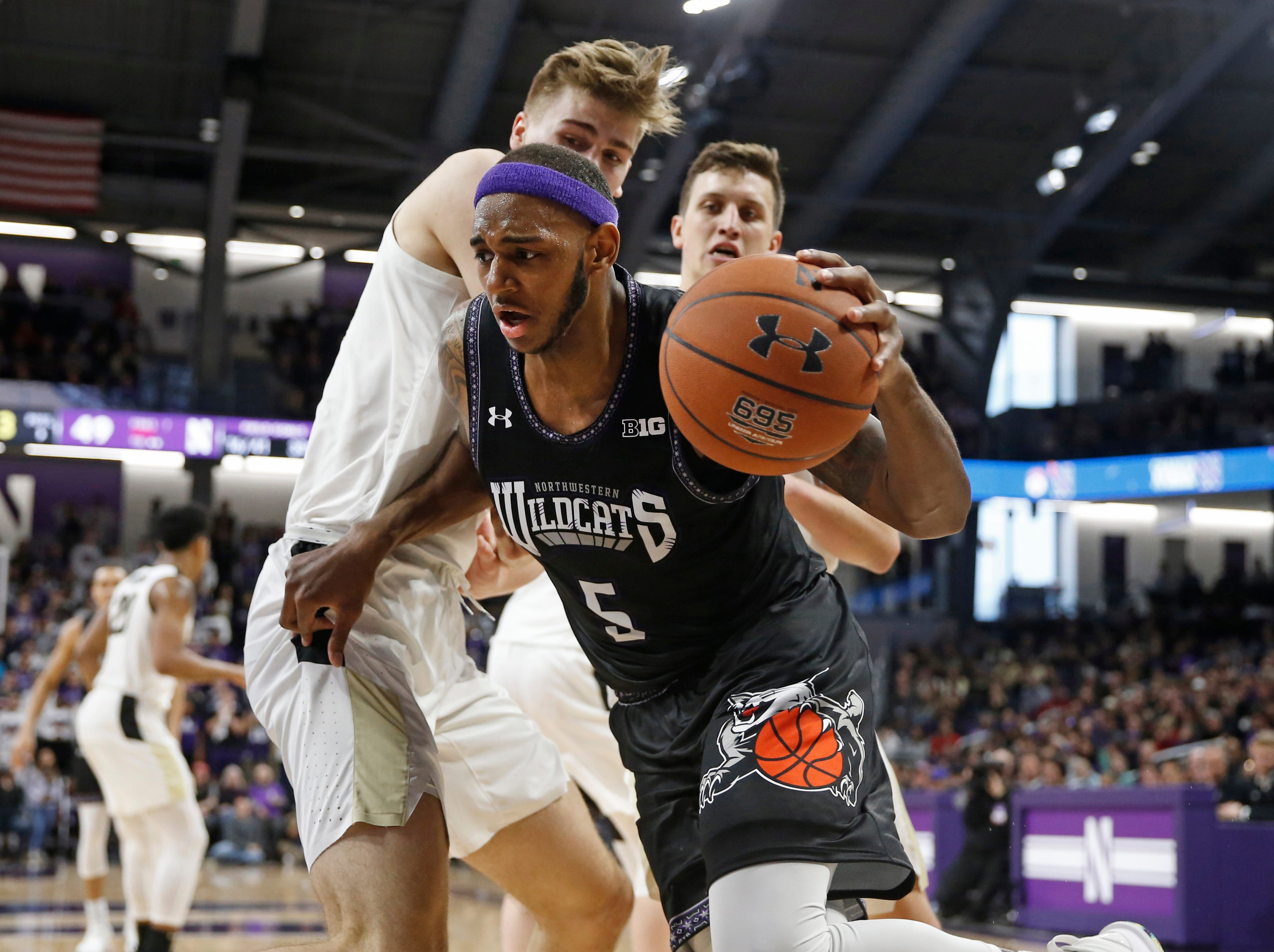 Mar 9, 2019; Evanston, IL, USA; Northwestern Wildcats center Dererk Pardon (5) drives around Purdue Boilermakers center Matt Haarms (left) during the second half at Welsh-Ryan Arena. Mandatory Credit: Nuccio DiNuzzo-USA TODAY Sports