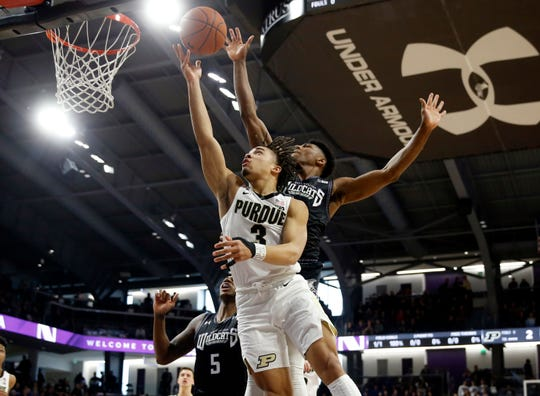 Mar 9, 2019; Evanston, IL, USA; Right Northwestern Wildcats guard Anthony Gaines (11) knocks the ball away from Purdue Boilermakers guard Carsen Edwards (3) during the first half at Welsh-Ryan Arena. Mandatory Credit: Nuccio DiNuzzo-USA TODAY Sports