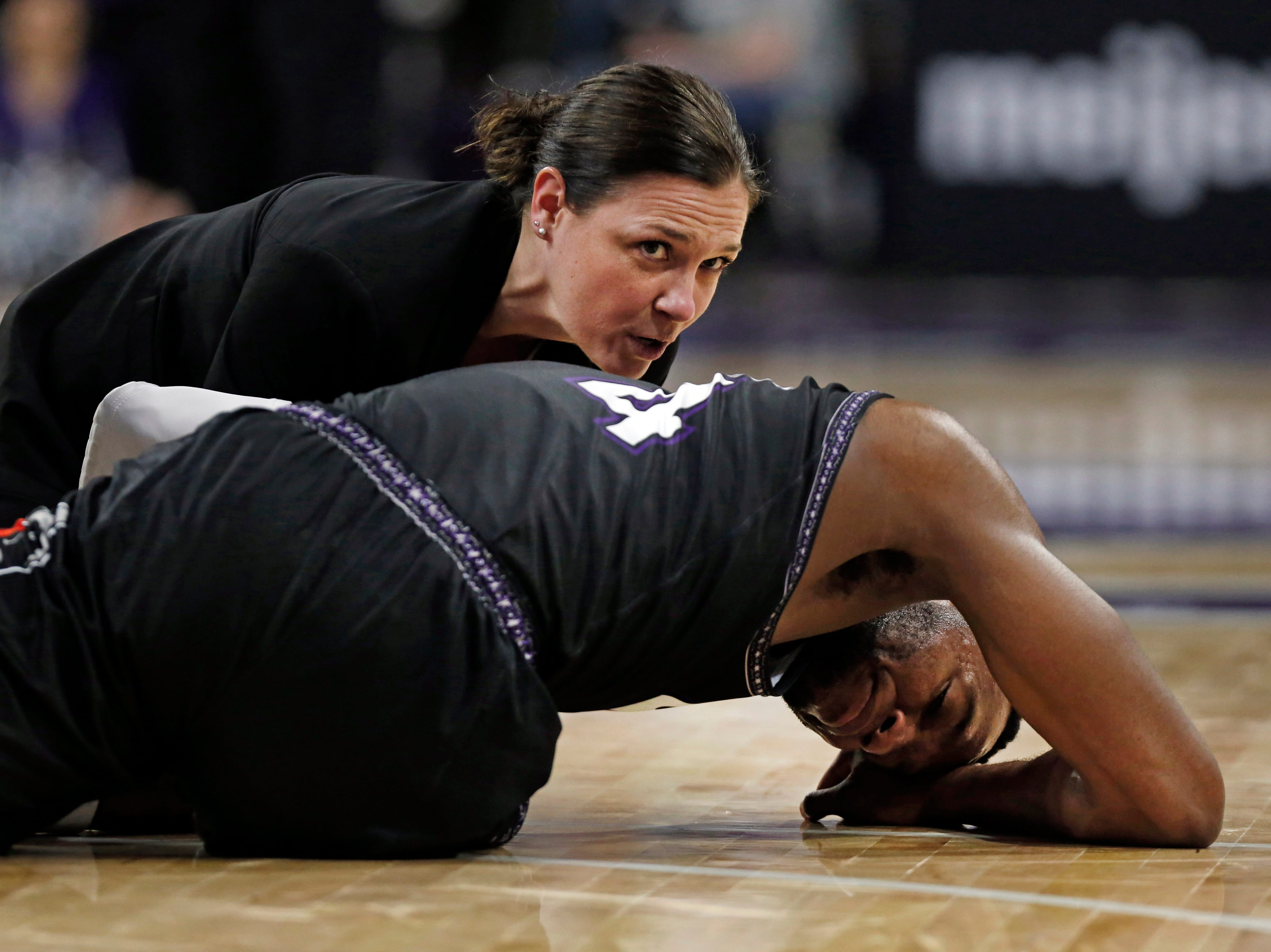 Mar 9, 2019; Evanston, IL, USA; Northwestern Wildcats forward Vic Law (4) reacts after being injuryed during the second half against the Purdue Boilermakers at Welsh-Ryan Arena. Mandatory Credit: Nuccio DiNuzzo-USA TODAY Sports