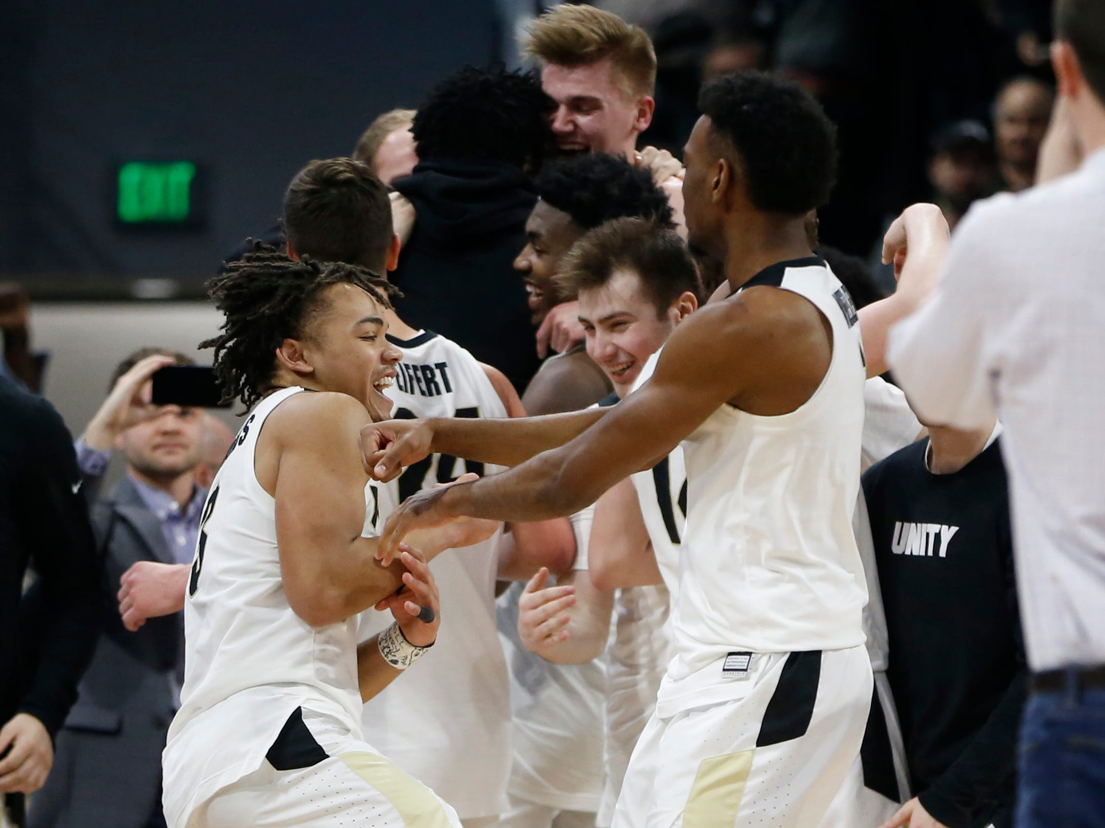 Mar 9, 2019; Evanston, IL, USA; Left Purdue Boilermakers guard Carsen Edwards (left) celebrates with teammates after defeating the Northwestern Wildcats at Welsh-Ryan Arena. Mandatory Credit: Nuccio DiNuzzo-USA TODAY Sports