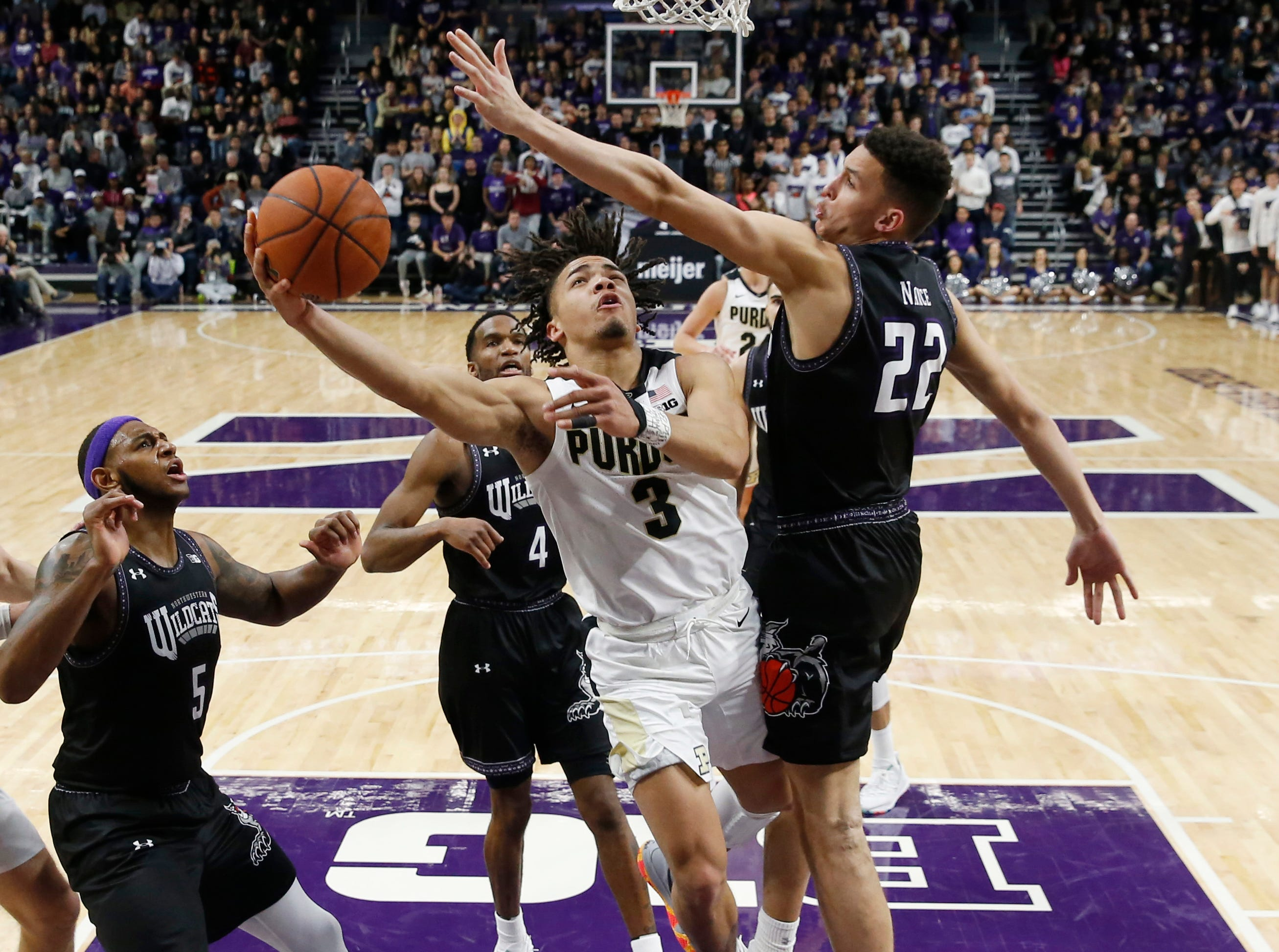 Mar 9, 2019; Evanston, IL, USA; Purdue Boilermakers guard Carsen Edwards (3) drives to the basket against Northwestern Wildcats forward Pete Nance (22) during the second half at Welsh-Ryan Arena. Mandatory Credit: Nuccio DiNuzzo-USA TODAY Sports