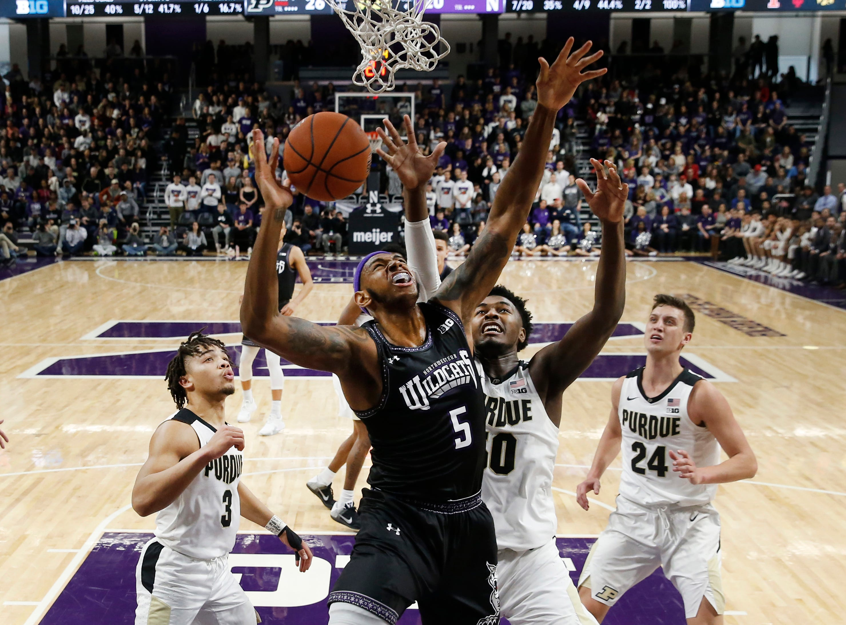 Mar 9, 2019; Evanston, IL, USA; Northwestern Wildcats center Dererk Pardon (5) shoots against Purdue Boilermakers forward Trevion Williams (50) during the first half at Welsh-Ryan Arena. Mandatory Credit: Nuccio DiNuzzo-USA TODAY Sports