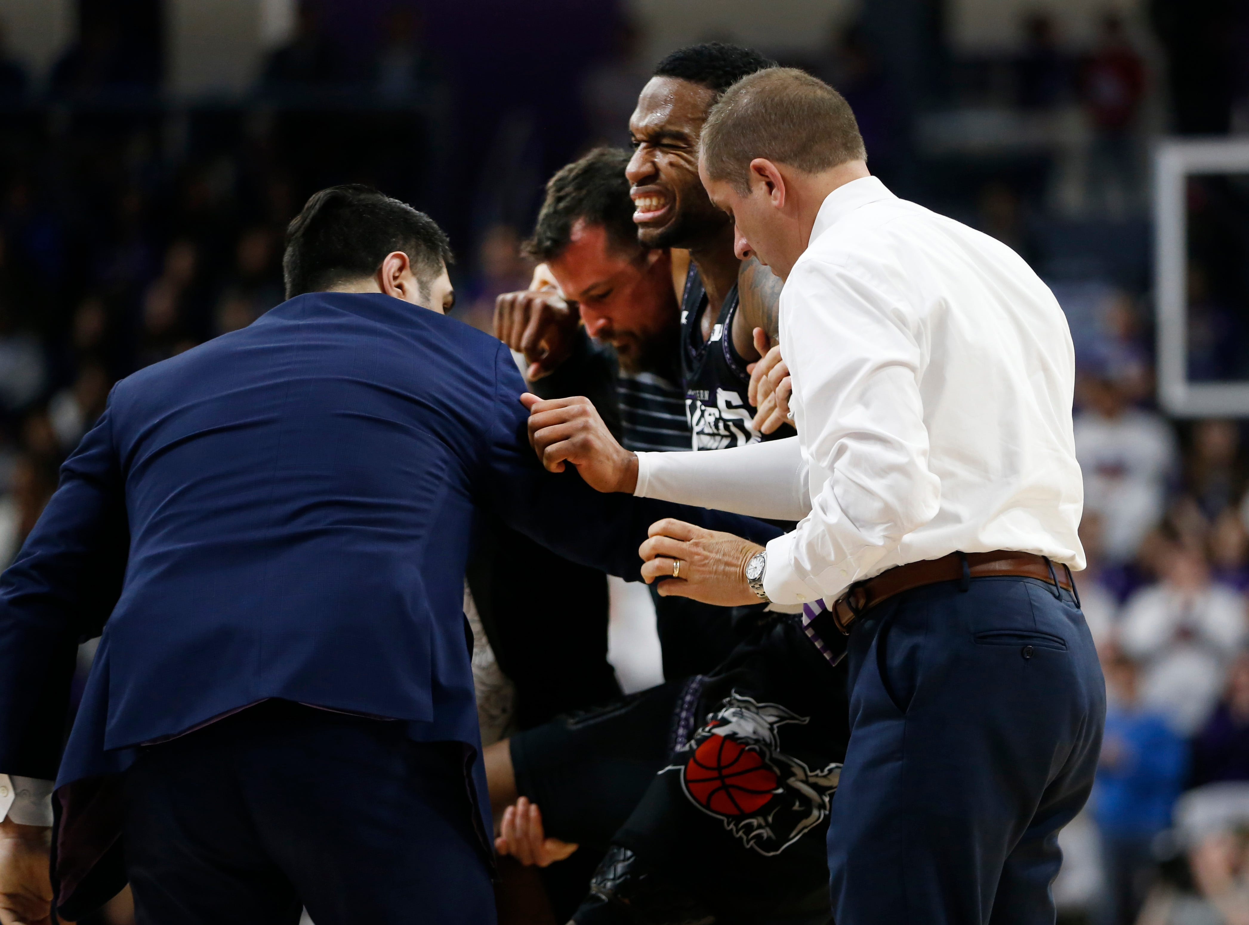 Mar 9, 2019; Evanston, IL, USA; Northwestern Wildcats forward Vic Law is helped off the floor after his injury during the second half against the Purdue Boilermakers at Welsh-Ryan Arena. Mandatory Credit: Nuccio DiNuzzo-USA TODAY Sports