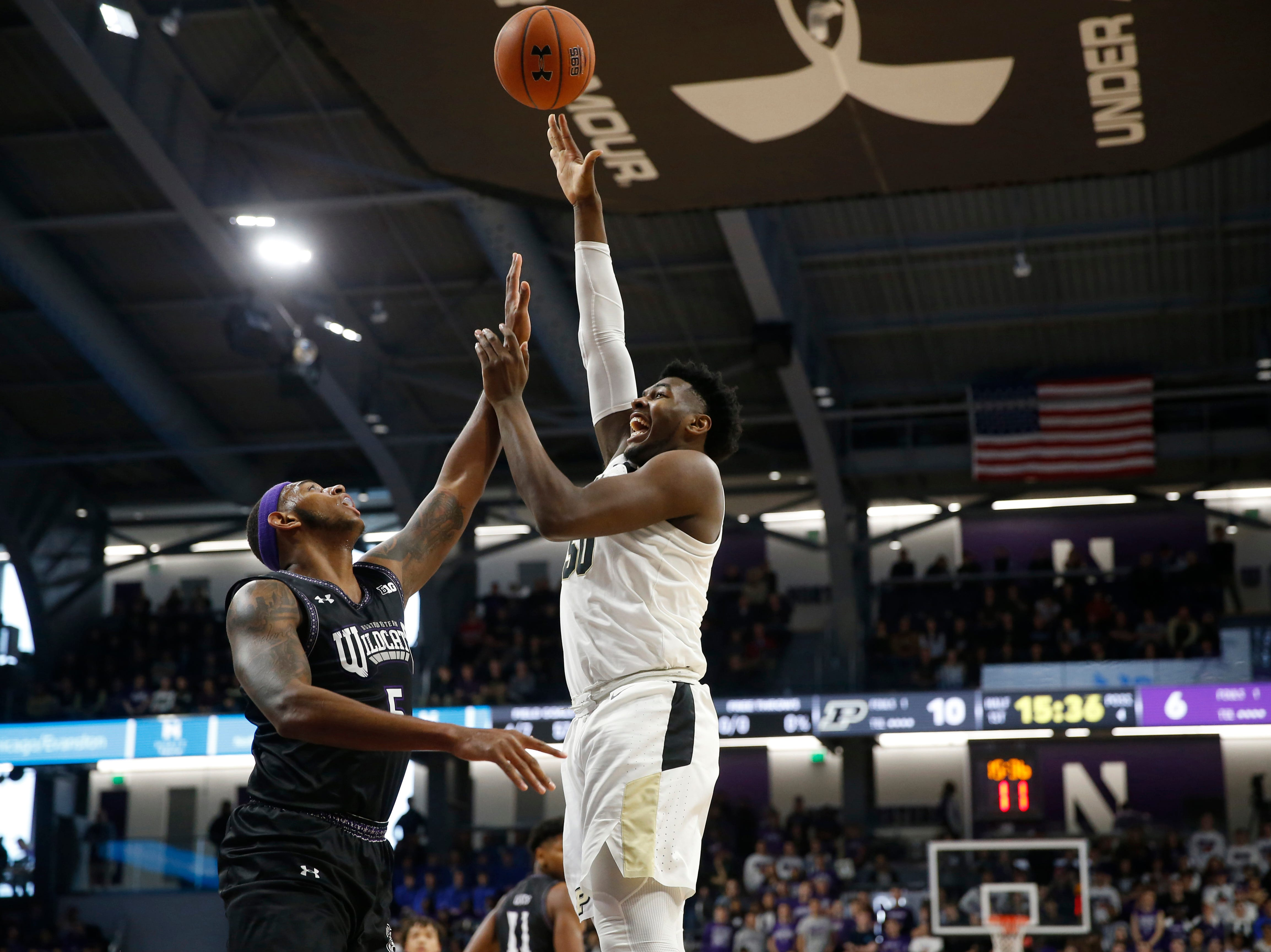 Mar 9, 2019; Evanston, IL, USA; Purdue Boilermakers forward Trevion Williams (50) shoots over Northwestern Wildcats center Dererk Pardon (5) during the first half at Welsh-Ryan Arena. Mandatory Credit: Nuccio DiNuzzo-USA TODAY Sports