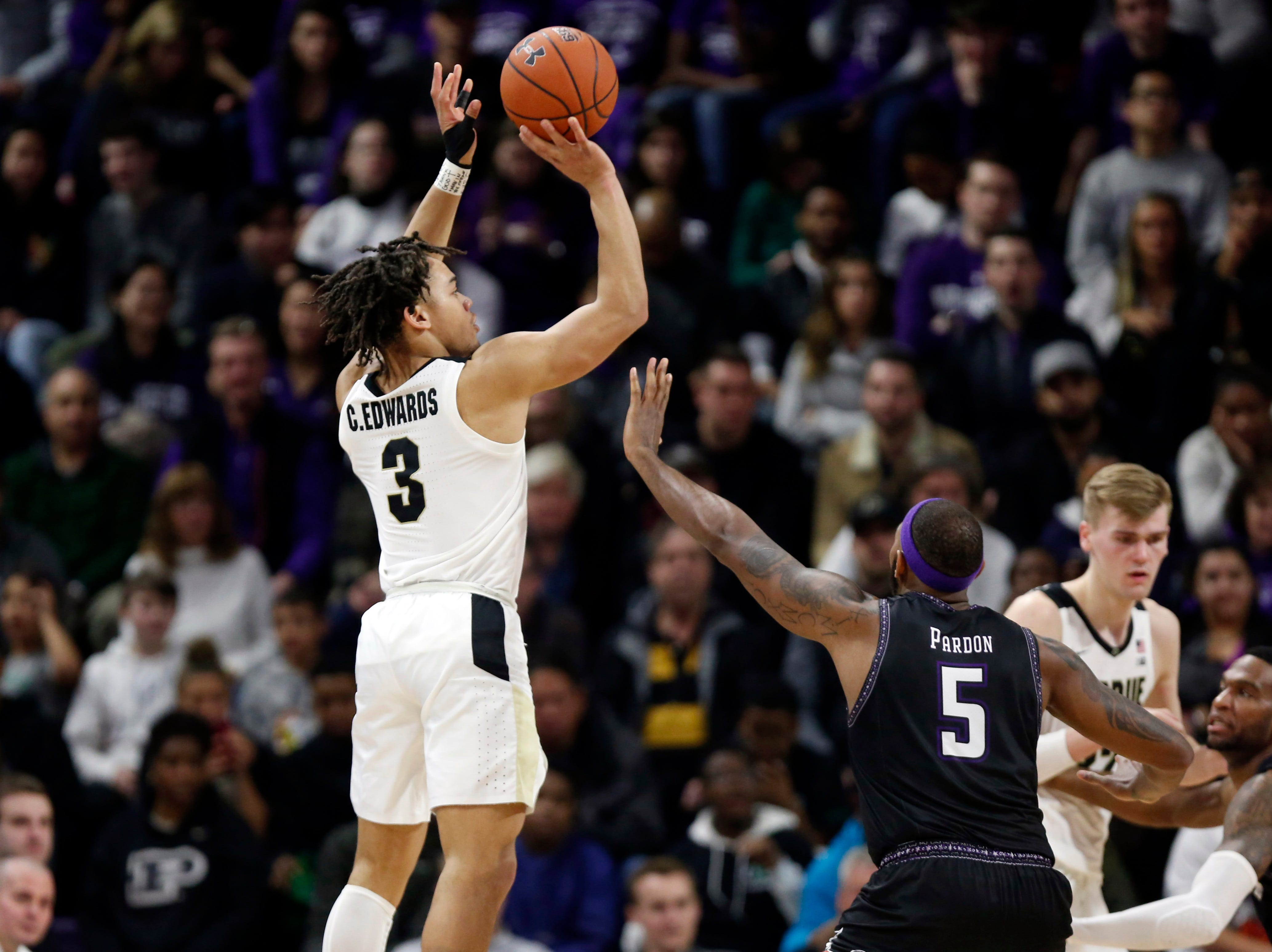 Mar 9, 2019; Evanston, IL, USA; Purdue Boilermakers guard Carsen Edwards (3) shoots over Northwestern Wildcats center Dererk Pardon (5) during the second half at Welsh-Ryan Arena. Mandatory Credit: Nuccio DiNuzzo-USA TODAY Sports