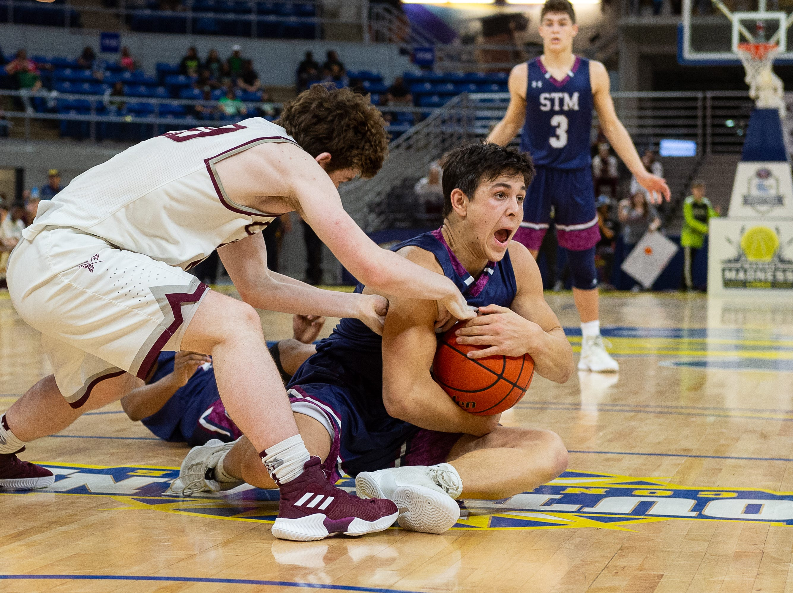 Jack Bech comes up with a lose ball as The STM Cougars beat DeLaSalle in double overtime to win the Allstate Sugar Bowl/LHSAA Boys' Marsh Madness Div II State Championship. Saturday, March 9, 2019.
