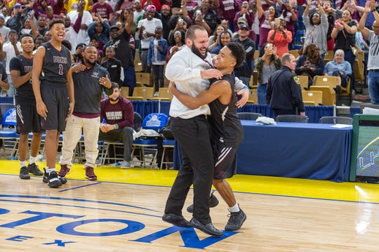 Seth Alexander hugs coach Chad Pourciau after Breaux Bridge beat Bossier, 61-58, to win the state championship March 8 in Lake Charles.