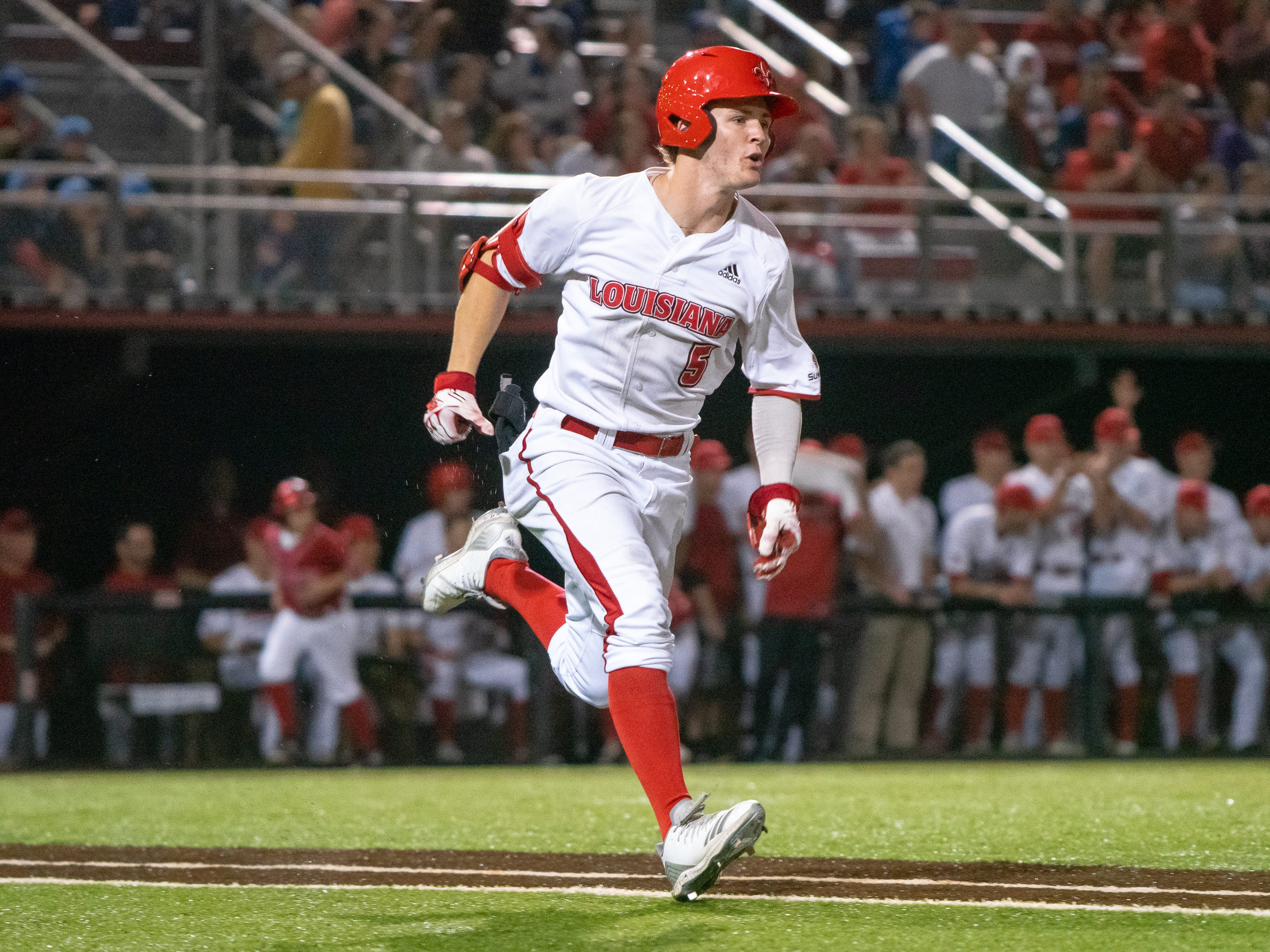 "UL's Hayden Cantrelle sprints to first base as the Ragin' Cajuns take on the Loyola Marymount Lions at M.L. ""Tigue"" Moore Field on Friday, March 8, 2019."