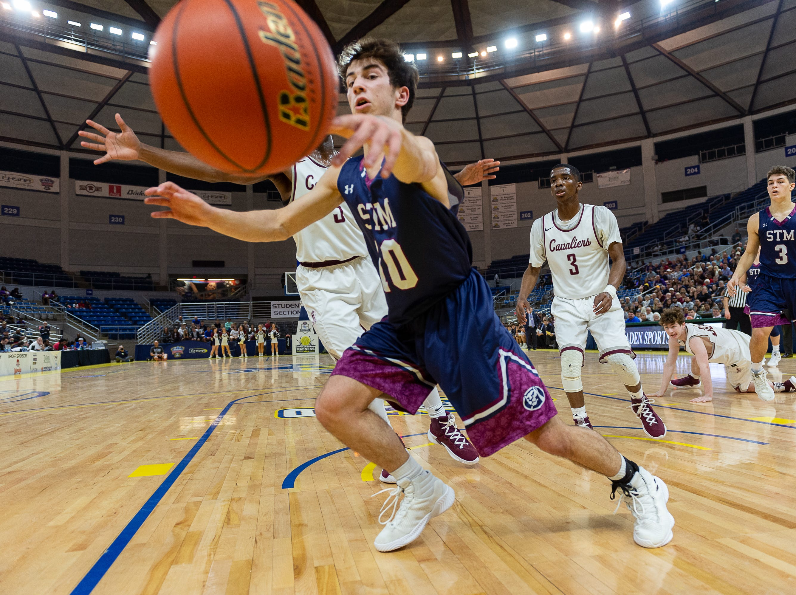 Reece Melancon gets a rebound as The STM Cougars beat DeLaSalle in double overtime to win the Allstate Sugar Bowl/LHSAA Boys' Marsh Madness Div II State Championship. Saturday, March 9, 2019.