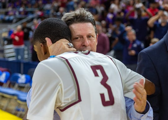 Cougars Head Coach Danny Broussard congratulates Ja'kobe Walker after the game.  The STM Cougars beat DeLaSalle in double overtime to win the Allstate Sugar Bowl/LHSAA Boys' Marsh Madness Div II State Championship. Saturday, March 9, 2019.
