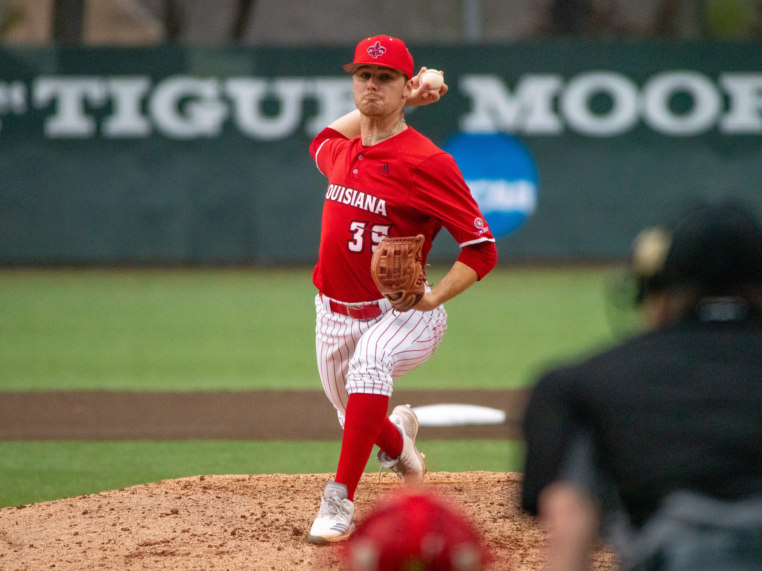 UL's Michael Leaumont pitches from the mound as the Ragin' Cajuns take on the Loyola-Marymount Lions at M.L. Tigue Moore Field on Saturday, March 9, 2019.