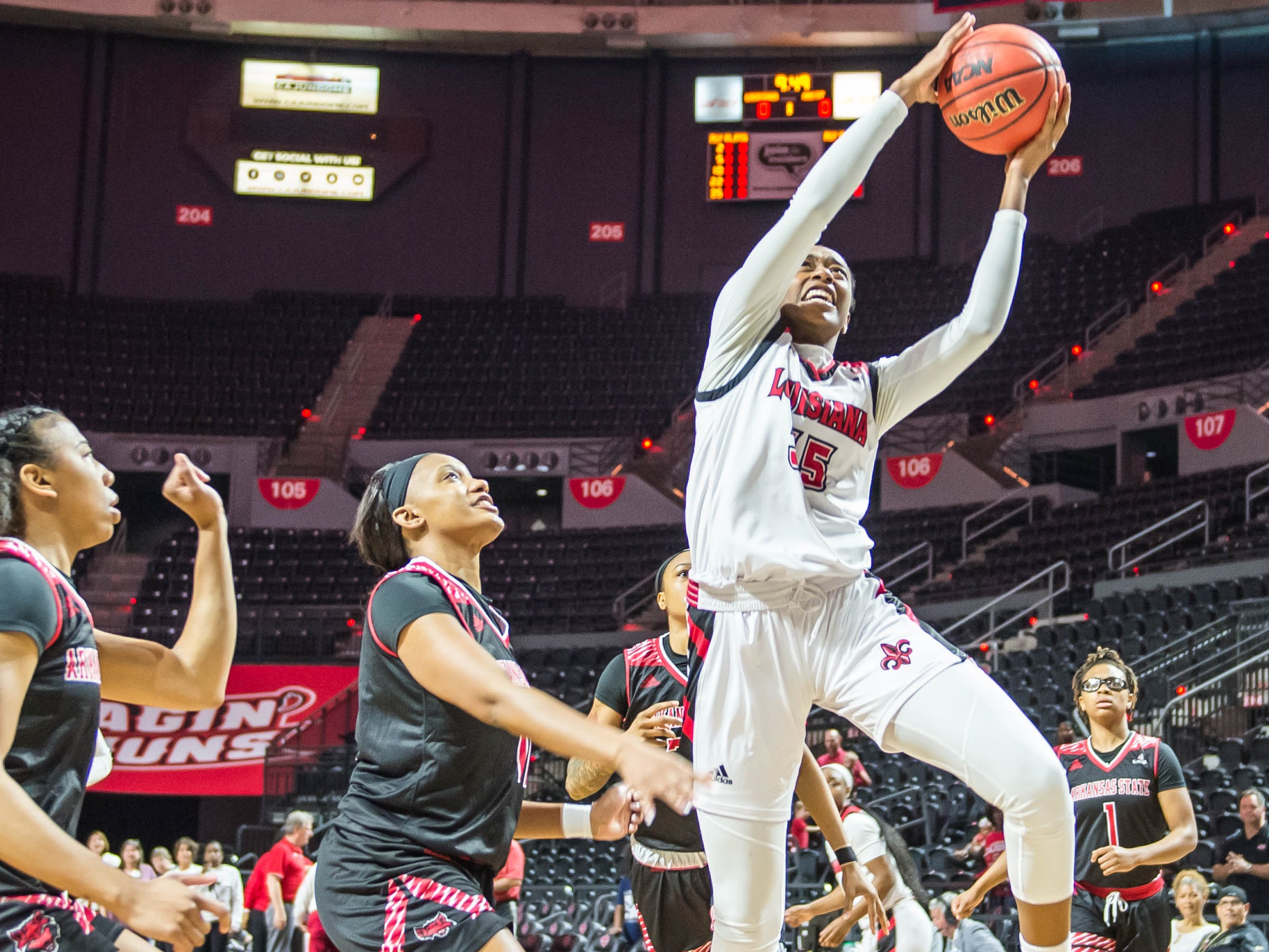 Cajuns center Ty'Reona Doucet (35) takes the ball to the basket as the Cajuns women's basketball team plays the Arkansas State Red Wolves at the Cajundome on Saturday, March 9, 2019.