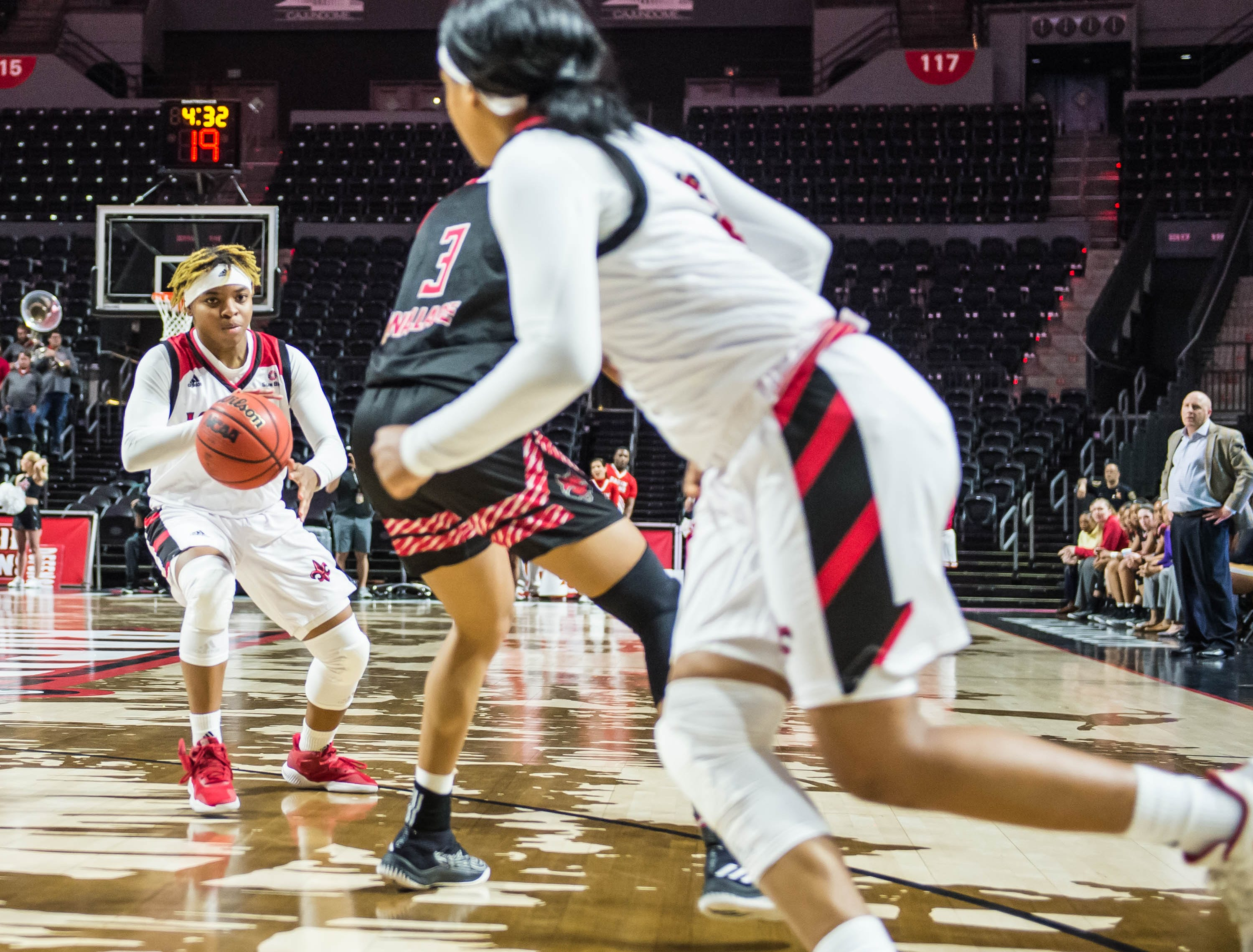 Cajuns guard Diamond Morrison (15) looks to pass the ball as the Cajuns women's basketball team plays the Arkansas State Red Wolves at the Cajundome on Saturday, March 9, 2019.