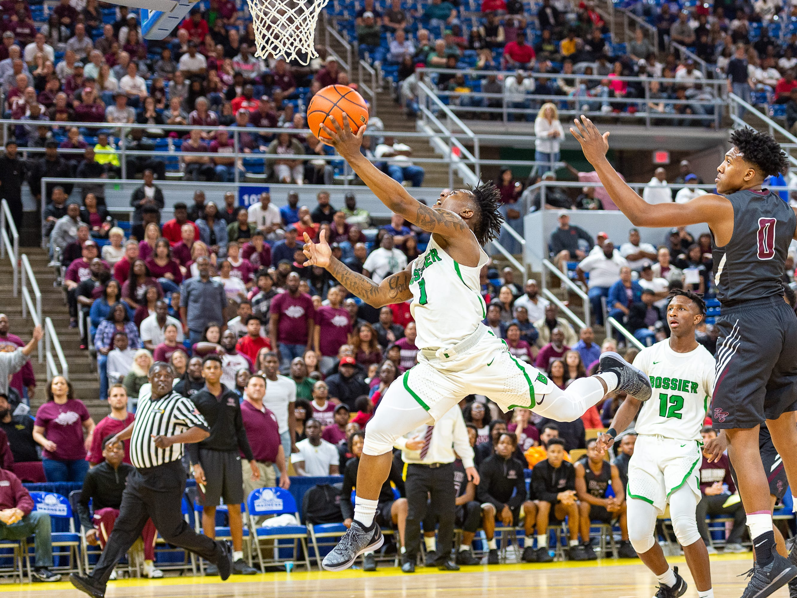 Jacoby Decker drives to the basket as Breaux Bridge takes on Bossier in the Allstate Sugar Bowl/LHSAA Boys' Marsh Madness State Championship. Friday, March 8, 2019.