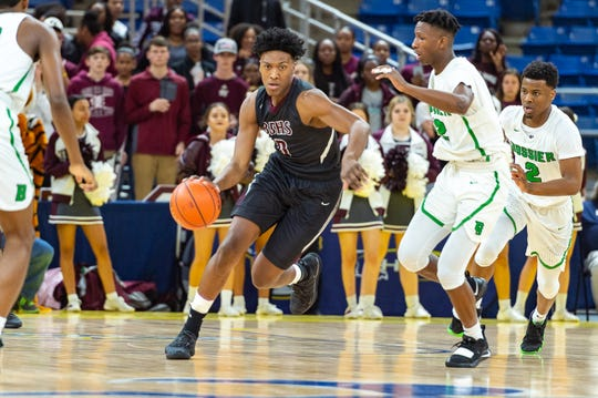 Deandre Hypolite drives the ball as Breaux Bridge takes on Bossier in the Allstate Sugar Bowl/LHSAA Boys' Marsh Madness State Championship. Friday, March 8, 2019.