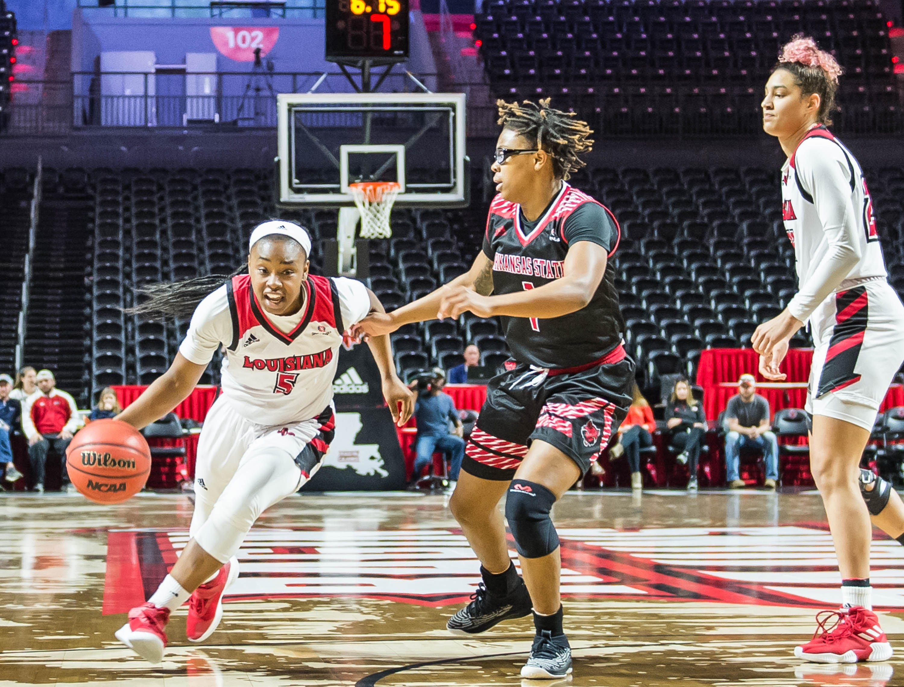 Ragin' Cajuns guard Jomyra Mathis (5) takes the ball up the middle as the Cajuns women's basketball team plays the Arkansas State Red Wolves at the Cajundome on Saturday, March 9, 2019.