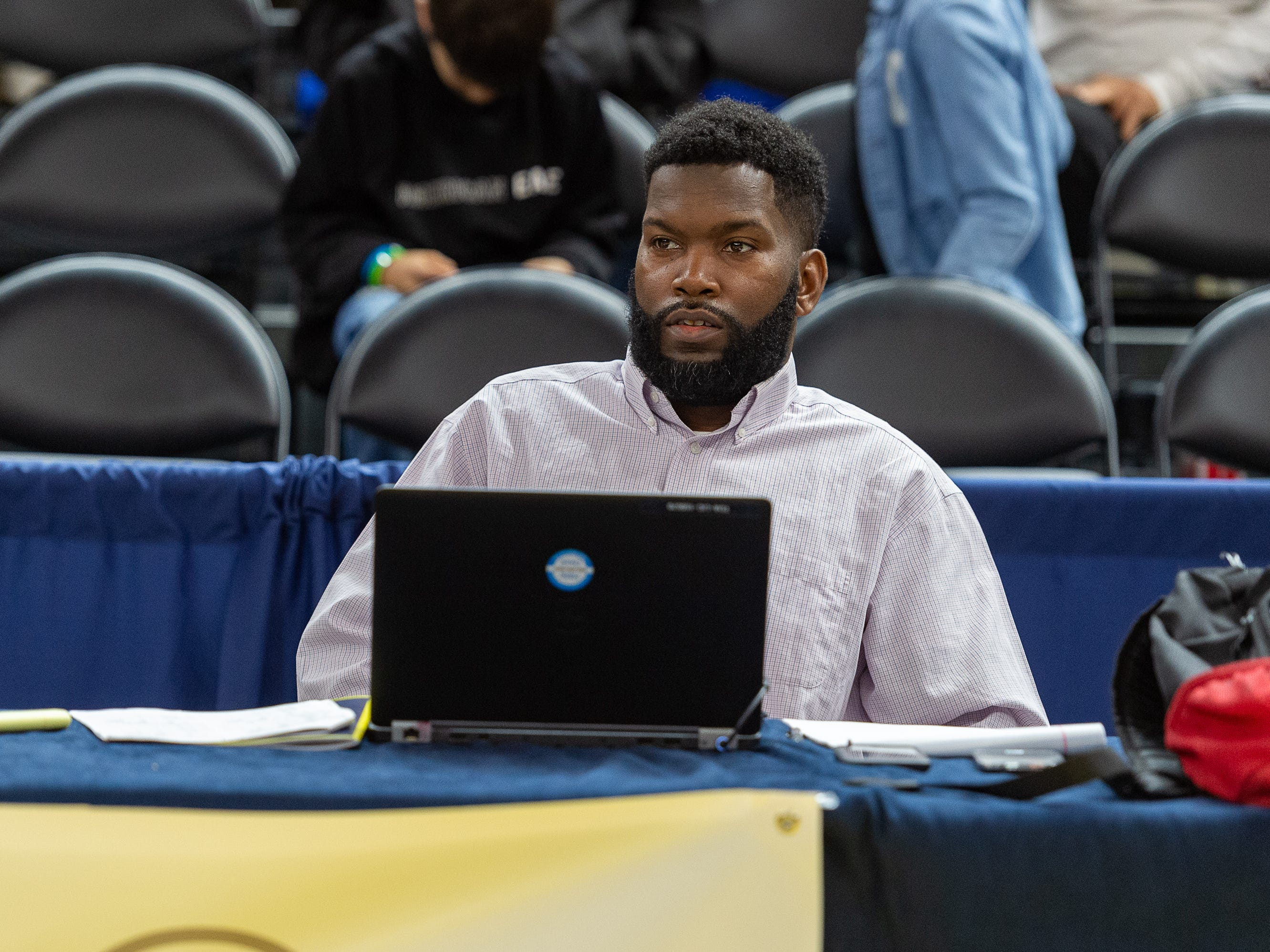 Sports Writer for The Advertiser, Eric Narcisse ,sitting courtside reporting the action as Lafayette Christian takes down Hamilton Christian to win the Allstate Sugar Bowl/LHSAA Boys' Marsh Madness State Championship. Friday, March 8, 2019.