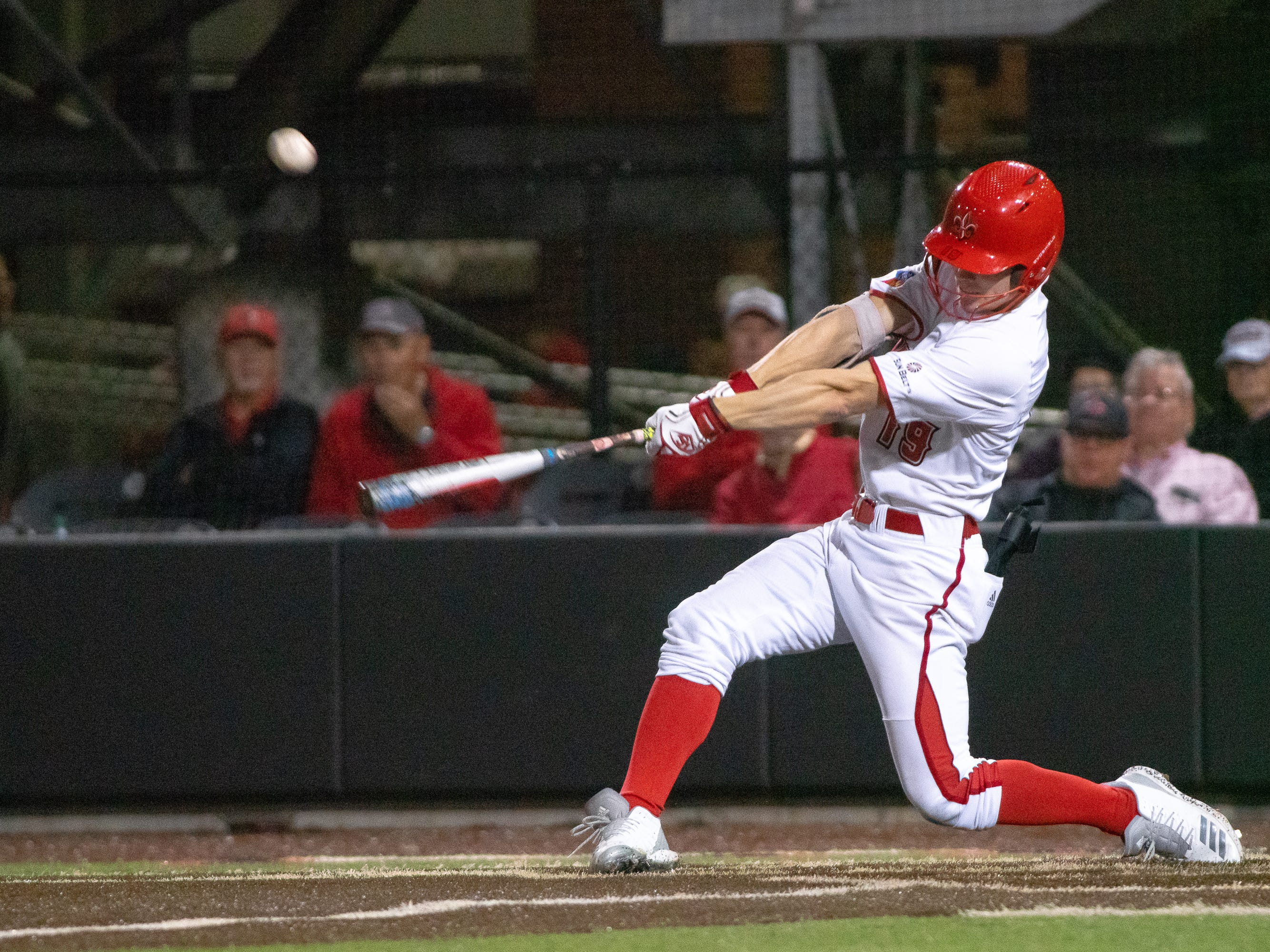 "UL's Hunter Kasuls hits the incoming pitch as the Ragin' Cajuns take on the Loyola Marymount Lions at M.L. ""Tigue"" Moore Field on Friday, March 8, 2019."