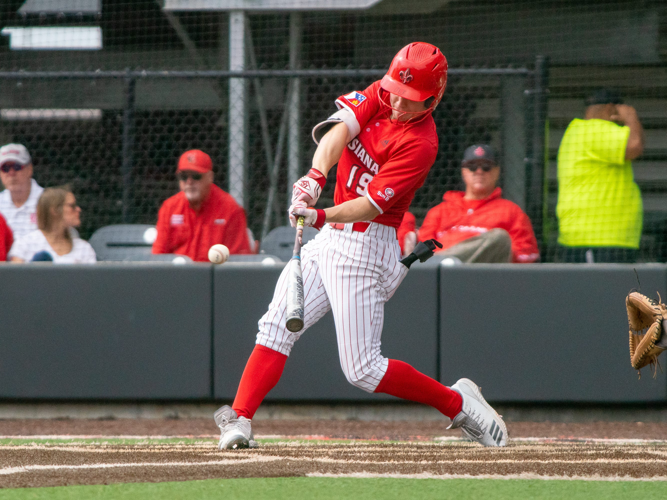 UL's Hunter Kasuls takes a swing at the pitch as the Ragin' Cajuns take on the Loyola-Marymount Lions at M.L. Tigue Moore Field on Saturday, March 9, 2019.
