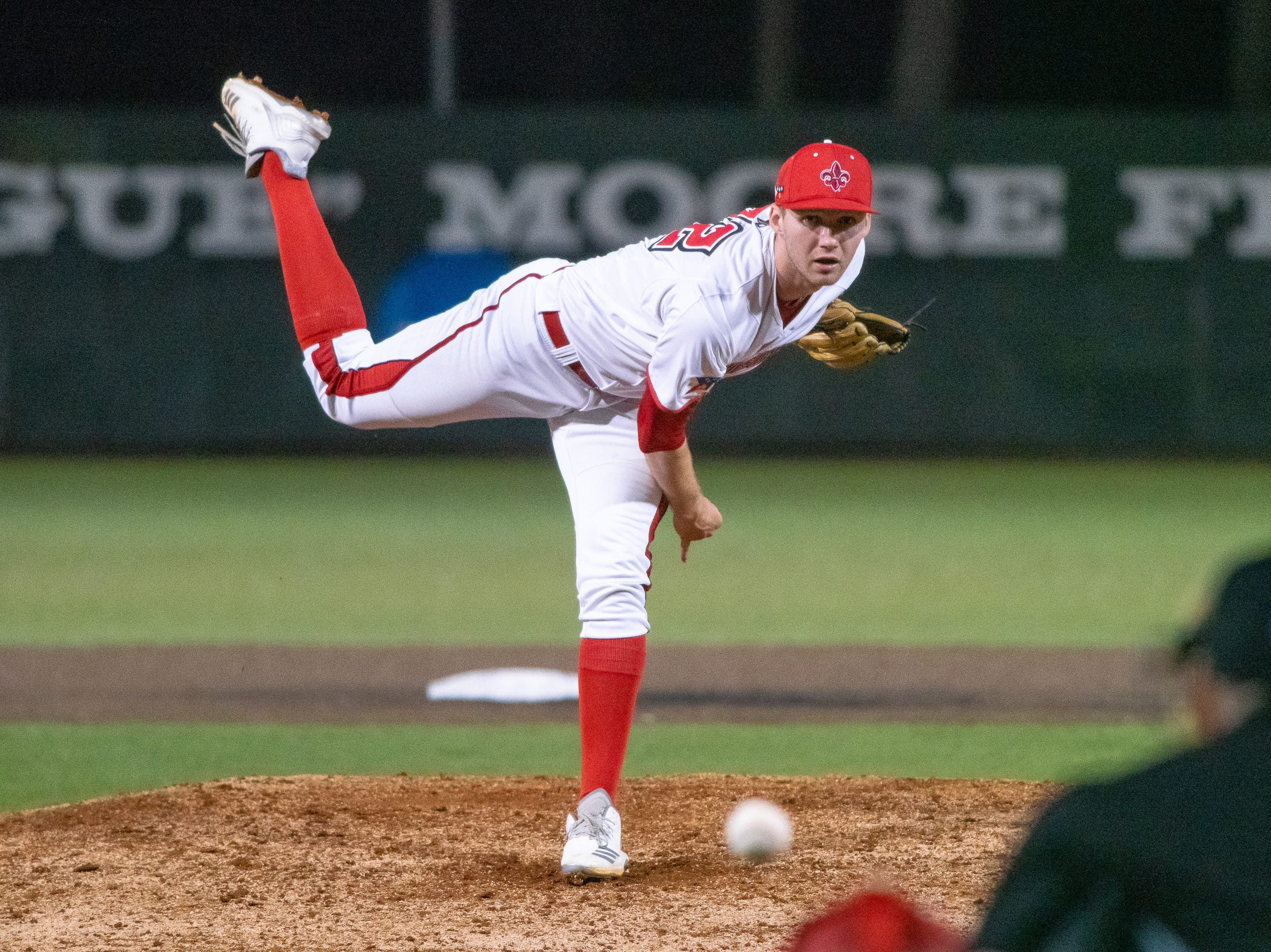 "UL's pitcher Brandon Young throws from the mound as the Ragin' Cajuns take on the Loyola Marymount Lions at M.L. ""Tigue"" Moore Field on Friday, March 8, 2019."