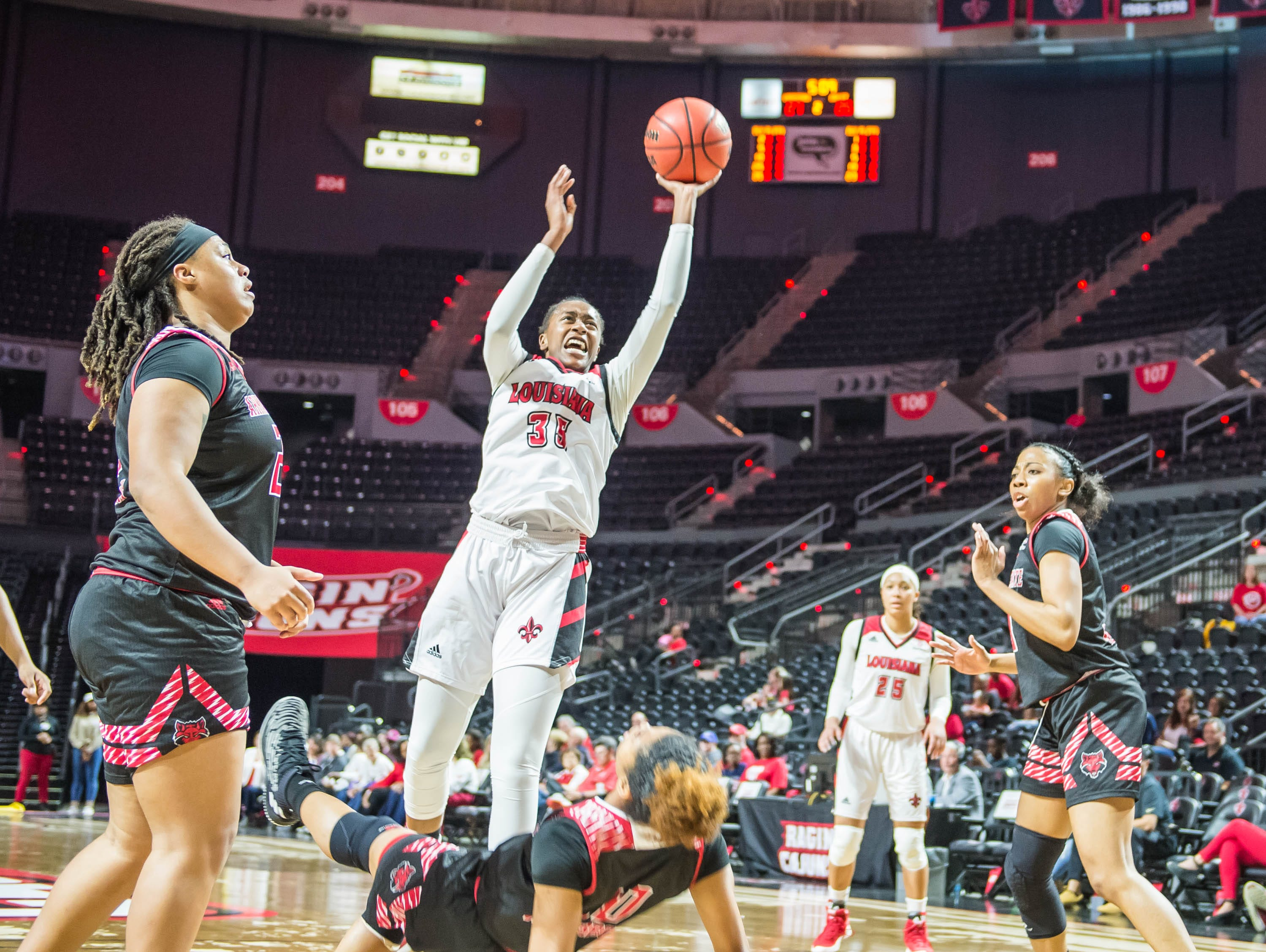 Cajuns center Ty'Reona Doucet (35) draws a charging call while going up for the layup as the Cajuns women's basketball team plays the Arkansas State Red Wolves at the Cajundome on Saturday, March 9, 2019.