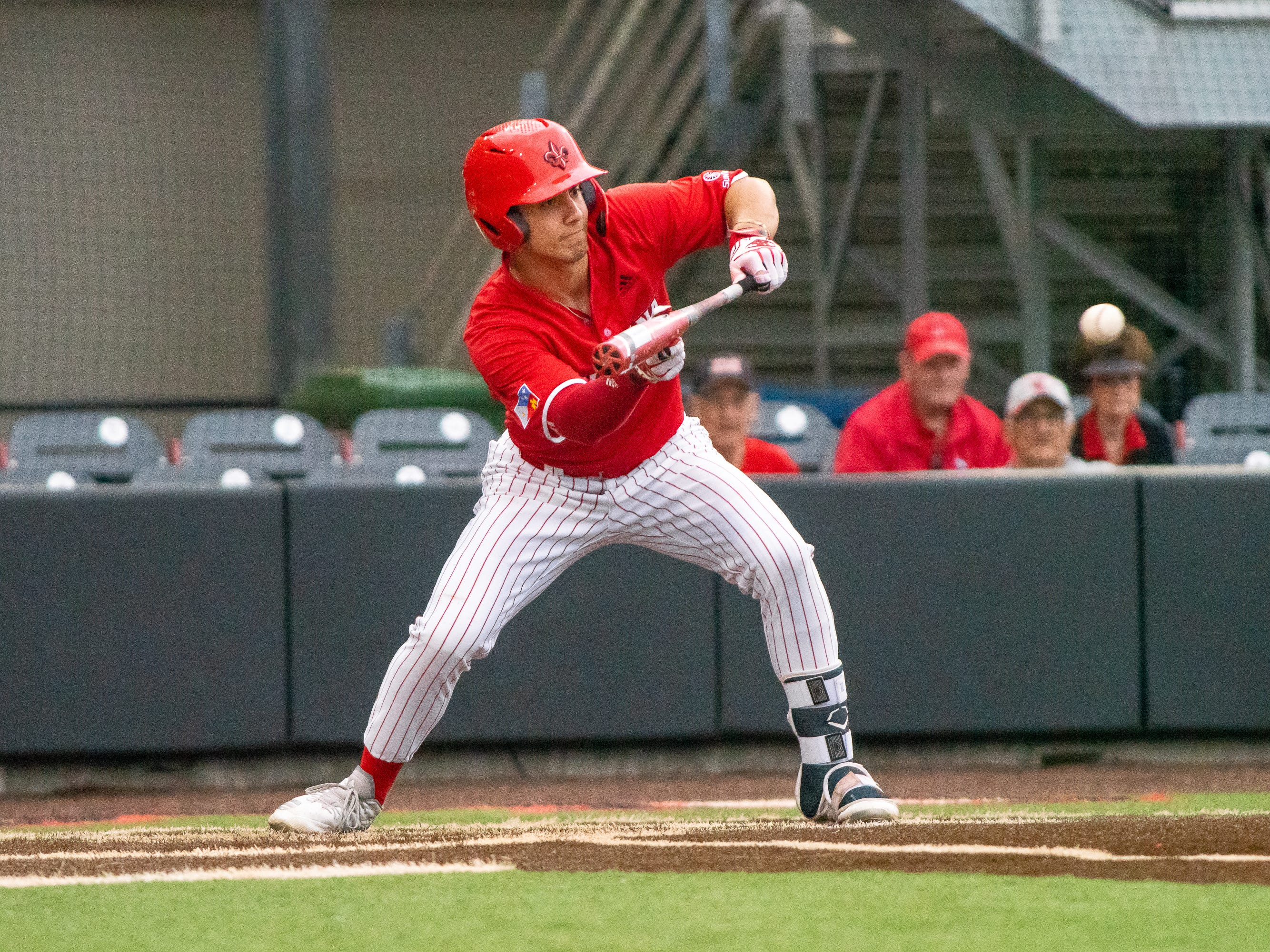 UL's Jonathan Windham prepares to bunt the ball as the Ragin' Cajuns take on the Loyola-Marymount Lions at M.L. Tigue Moore Field on Saturday, March 9, 2019.
