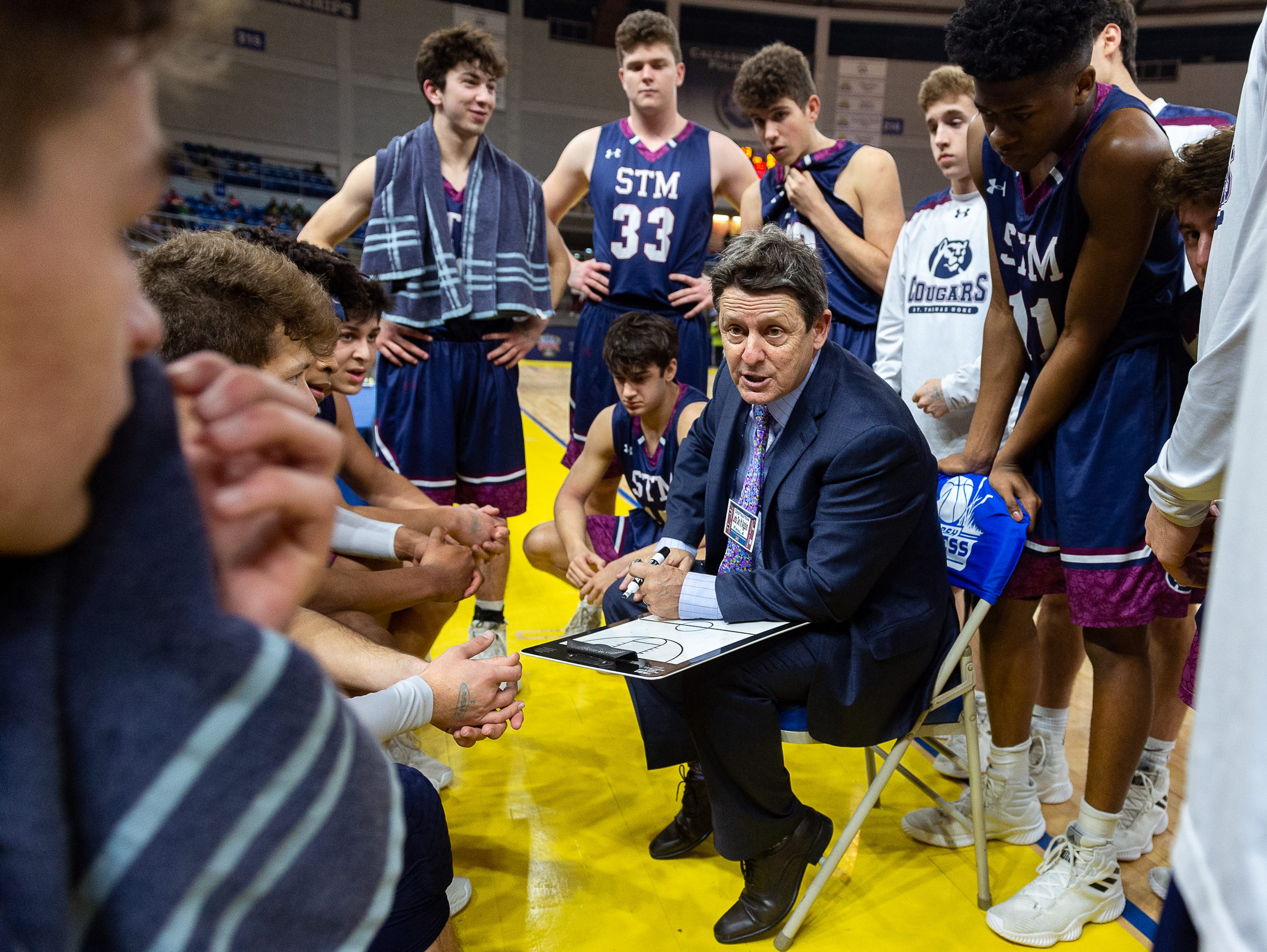 Cougars Head Coach Danny Broussard in the huddle as The STM Cougars beat DeLaSalle in double overtime to win the Allstate Sugar Bowl/LHSAA Boys' Marsh Madness Div II State Championship. Saturday, March 9, 2019.