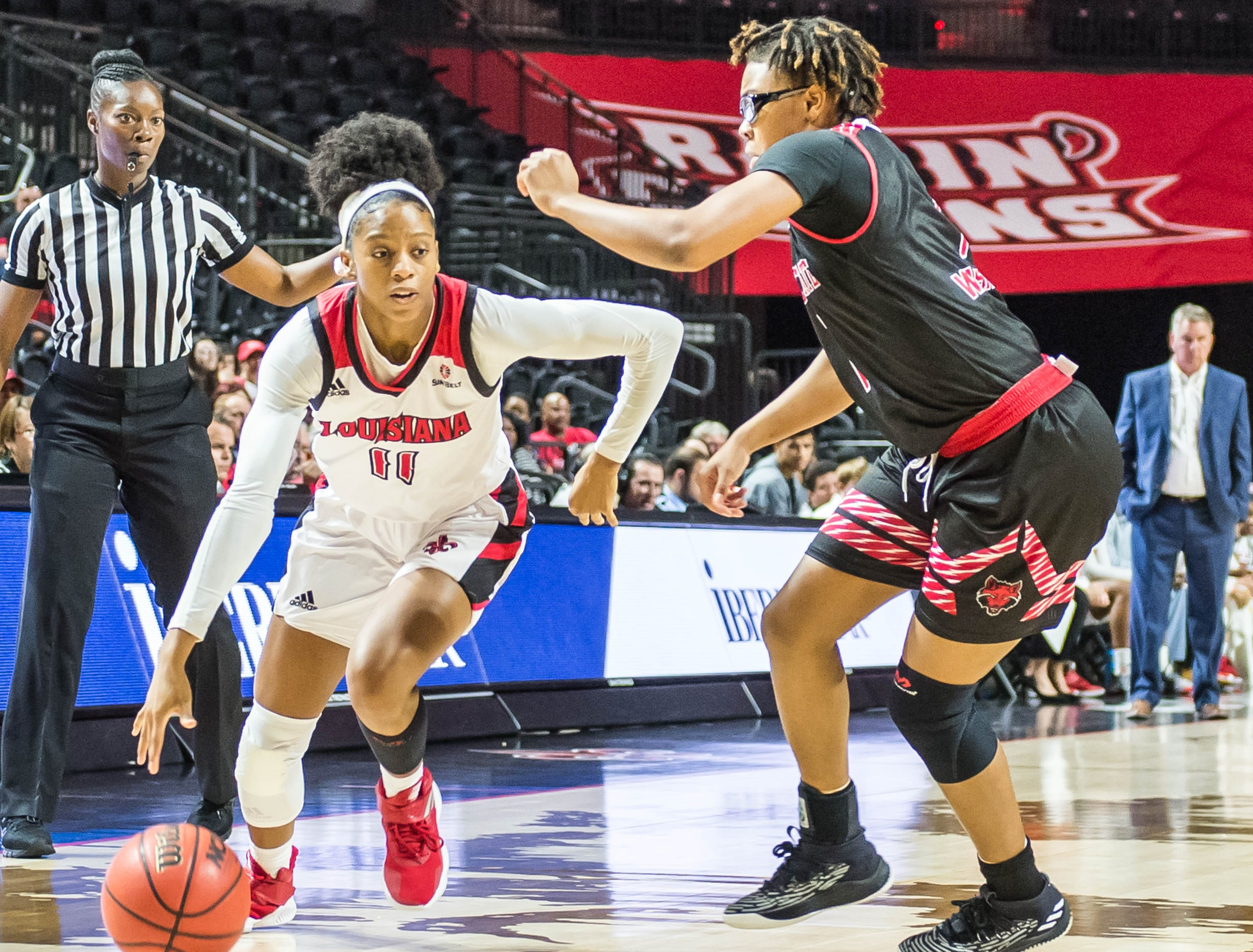 Cajuns guard Skyler Goodwin (11) tries to take the ball to the inside as the Cajuns women's basketball team plays the Arkansas State Red Wolves at the Cajundome on Saturday, March 9, 2019.