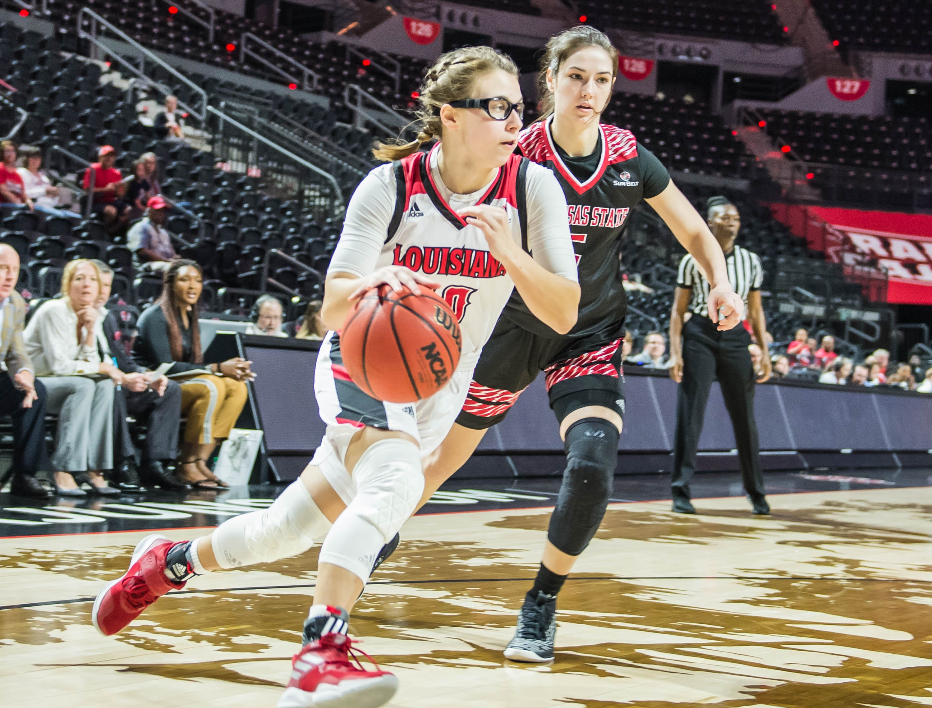 Andrea Cournoyer (10) works the baseline to the basket as the Cajuns women's basketball team plays the Arkansas State Red Wolves at the Cajundome on Saturday, March 9, 2019.