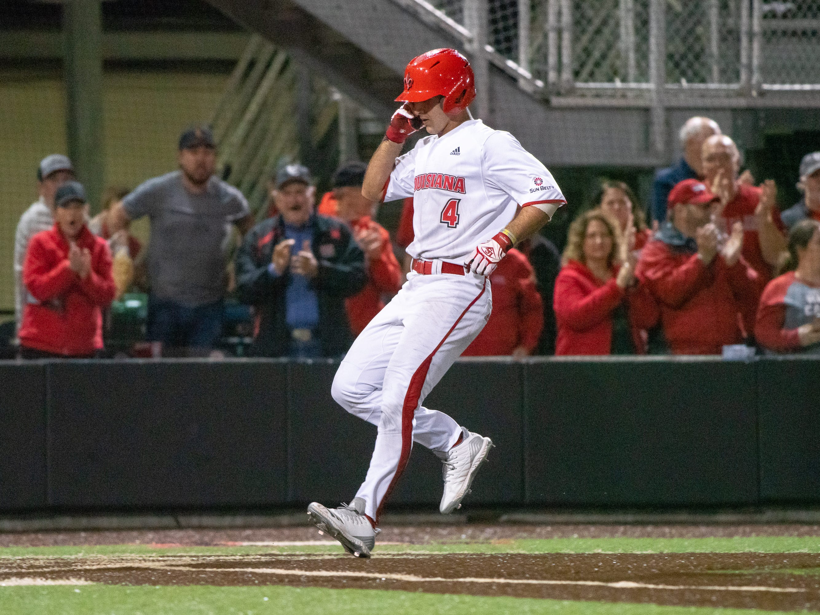"UL's Brennan Breaux walks onto home plate after hitting a home run as the Ragin' Cajuns take on the Loyola Marymount Lions at M.L. ""Tigue"" Moore Field on Friday, March 8, 2019."