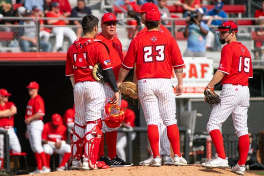 UL coach Tony Robichaux holds a meeting on the mound during Saturday's loss to Loyola Marymount.