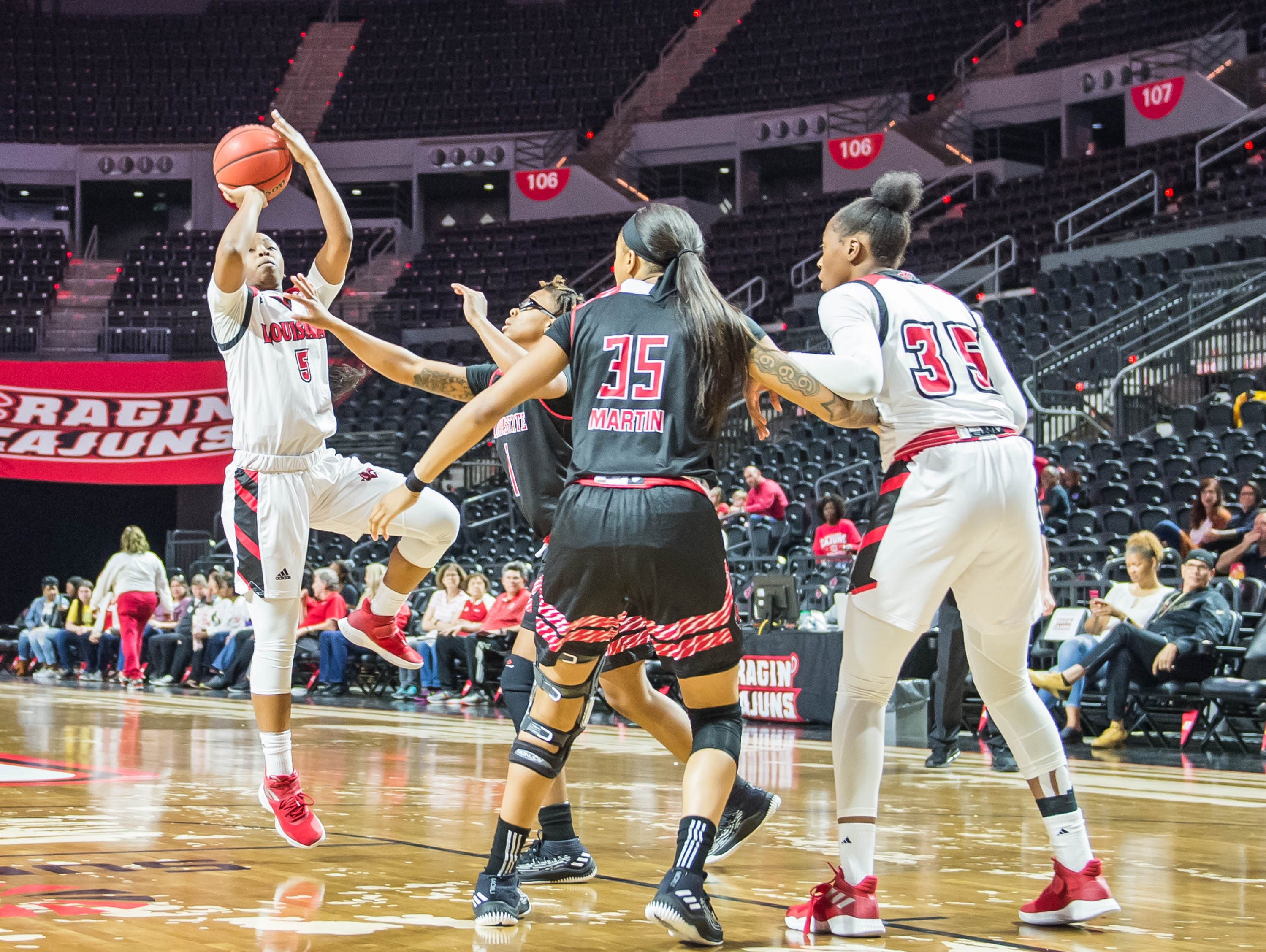 Ragin' Cajuns guard Jomyra Mathis (5) with the jump shot as the Cajuns women's basketball team plays the Arkansas State Red Wolves at the Cajundome on Saturday, March 9, 2019.